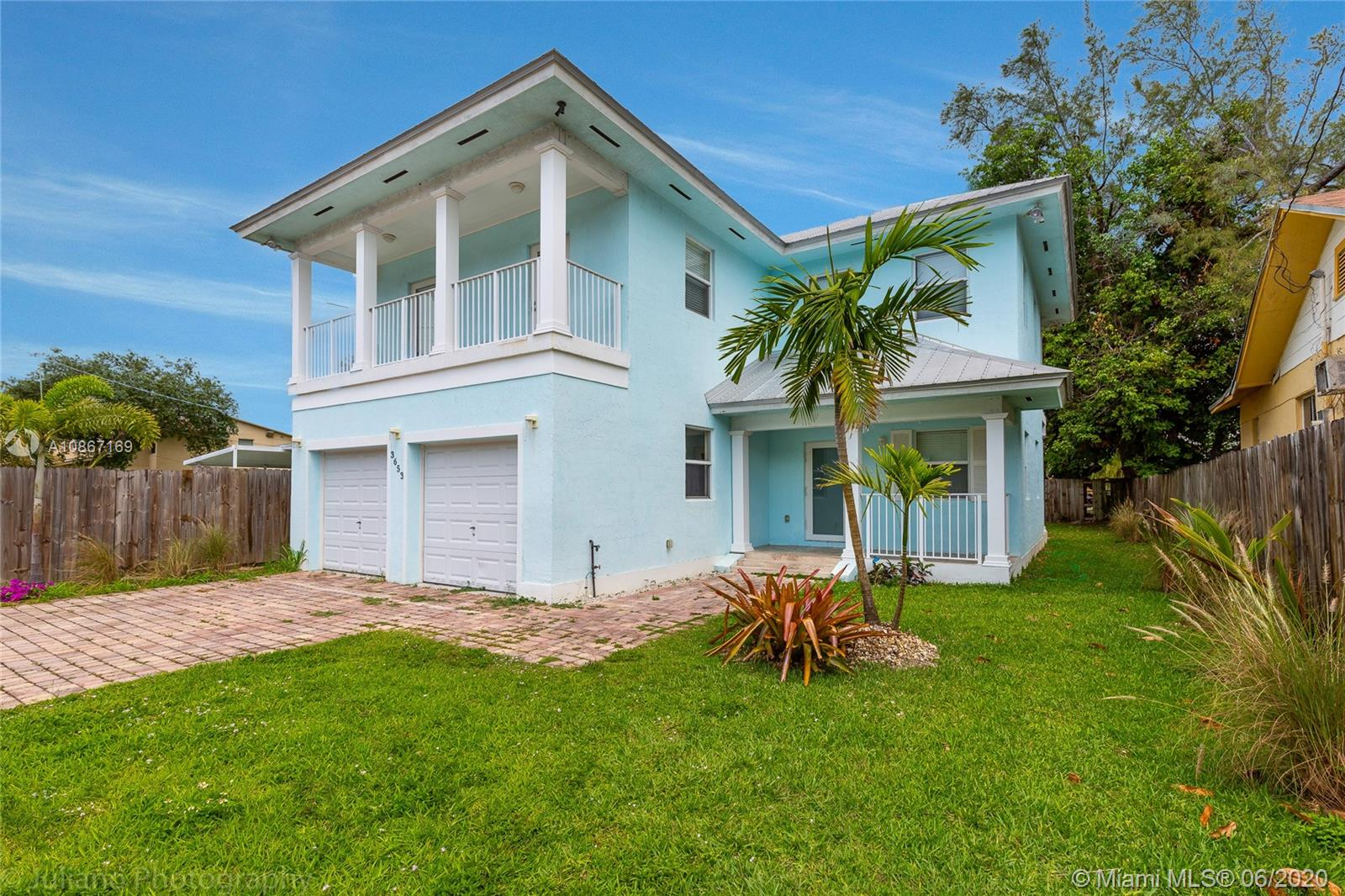 """Key West"" two-story house built in 2007. Impact windows and doors. Metal roof. Premises fully fenced. Close to everything. Beautiful garden w/ pool.