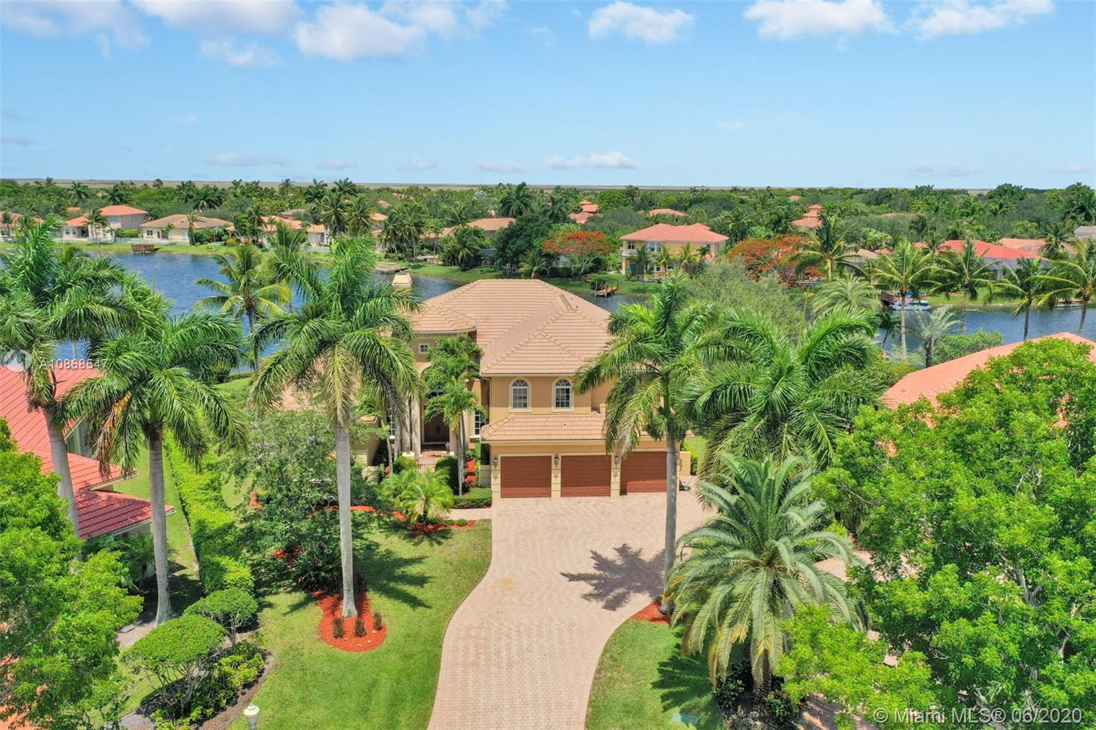 """WOW! ONE OF THE MOST SPECTACULAR HOMES IN ALL OF CORAL SPRINGS LOCATED ON A PRIME TIME .46 ACRE POINT LOT WITH 177' DIRECTLY ON BOATABLE LAKE CORAL SPRINGS INCLUDING DOCK! MAGNIFICENT TOP TO BOTTOM WITH THE FINEST IN CRAFTSMANSHIP! 6 BR + LOFT + OFFICE + 4 CAR GARAGE (6TH BR CURRENTLY OPEN TO LOFT & 4TH GARAGE IS TANDEM WITH A/C AND SIDE ENTRY). IMPACT WINDOWS & DOORS! 24"""" SATURNIA FLOORS! GOURMET KITCHEN! 750 SQ. FT. LOGGIA WITH SUMMER KITCHEN AND GAS COOKING! PLETHORA OF UPGRADES LISTED ON FACT SHEET! MUST SEE!"""