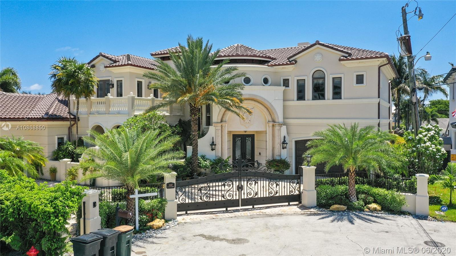 Timeless Mediterranean gated Lighthouse point estate w/270' of water frontage. The dock will take up to a 135' yacht with plenty of electrical power to run all the boats. The dock also includes 2 large hurricanes lifts to keep your 40ft plus toys out of the water and another lift for your 3 jet skis! Chef's kitchen w/Wolf appliances, gas range, SubZero refrigerator & 2 dishwashers. Master suite w/balcony & water view.media room & office. Smart home technology, sound system & alarm security system cameras-direct police call alarm system security. Wired: zone sound & cameras. Air-conditioned garages, elevator. New heated saltwater pool & gas summer kitchen that will rival any tropical pool and Lush tropical landscaping. All-new A/C units. Property gates w/remote control access.One of a kind!