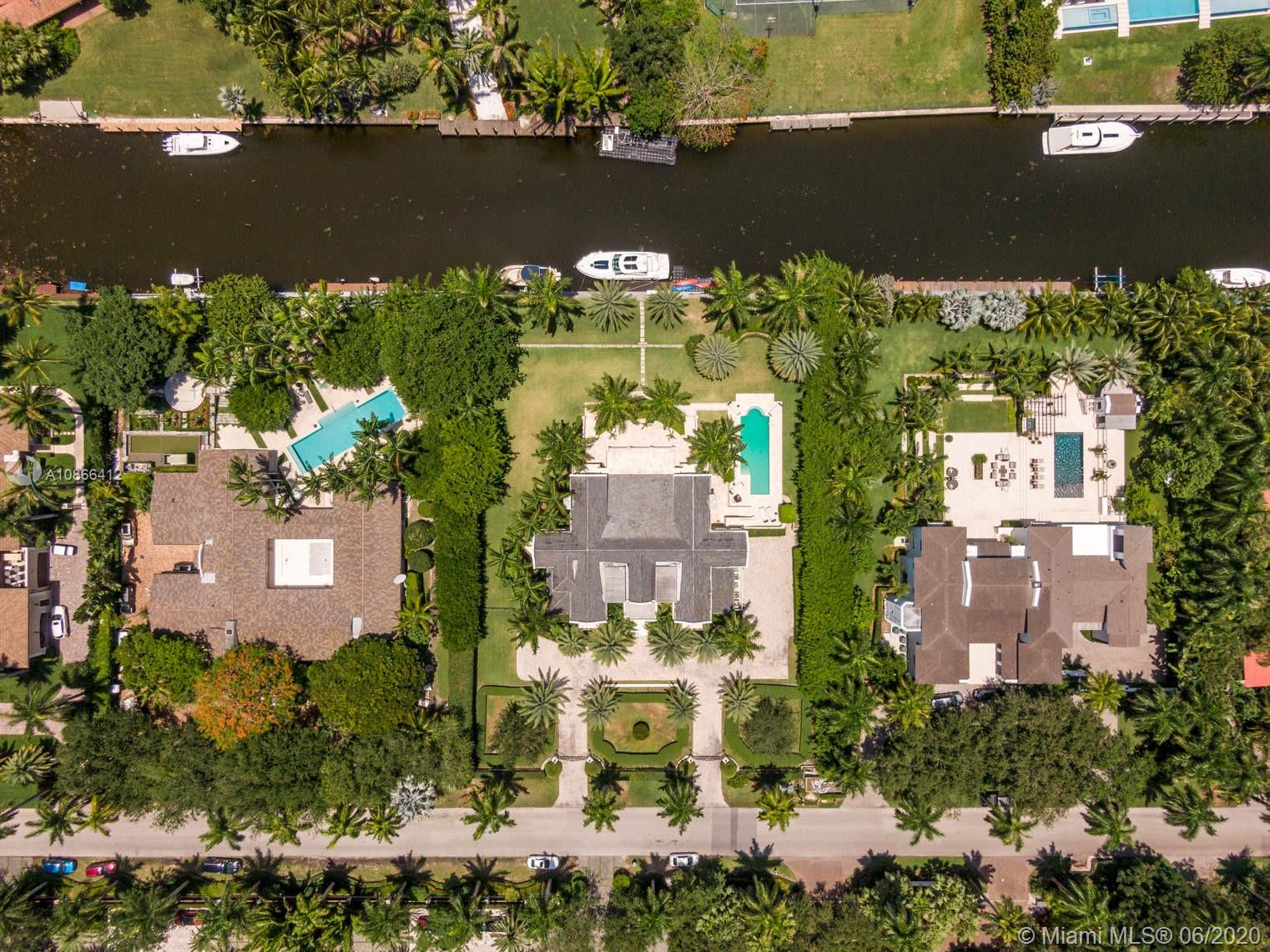 Impressive boater's dream mansion with 180ft of waterfront, a 20,000lb boat lift with unobstructed access to the Atlantic Ocean. Conveniently elevated against floods, this gorgeous estate holds the best value/sqft in the prestigious Gables Estates gated community. Classic luxury and modern style blend into a gorgeous estate as you walk on its marble floors adorned by dramatic double height-ceilings, east & west wings, and imperial stairways. Spectacular water views and open balcony from Master bedroom, encompassing an office, his and hers closets, and a sumptuous bathroom, all connected through its own private vestibule. An elevator services all levels. Reserved pool with access to 2 full bathrooms and a bonus entertainment area. 4 car garage + guest parking via an u shaped gated driveway!