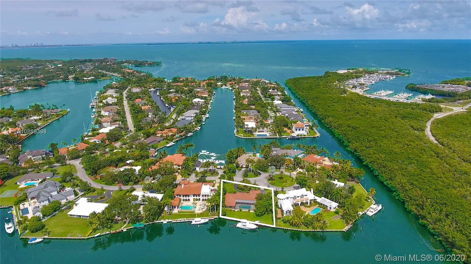 Enjoy lovely, unusually wide canal views from this highly desirable Old Cutler Bay address on gorgeous Gallardo Street. This lush half-acre sits on a beautiful cul-de-sac with 137 feet of prime waterfront boasting direct bay access with no bridges. Custom-build your dream home or remodel the existing house with interior features that include marble floors, large kitchen with granite countertops, an expansive master with his/hers baths & walk-in closets. Dock amenities include jet ski davit, electric and water. Ideally situated near top-tier schools, world-class parks, renowned hospitals, boutique shopping and cosmopolitan dining. Enjoy 24-hour guard-gated security with roaming patrol.