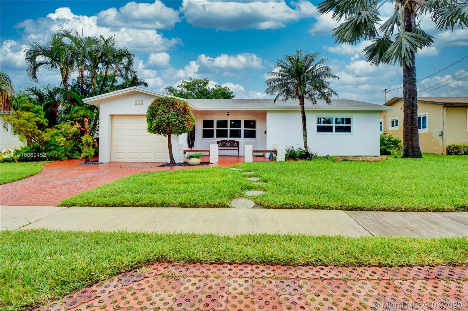 Perfect home for boaters who want easy Ocean Access. Just off the Dania Cutoff Canal, close to the Intracoastal and Port Everglades! Only one fixed bridge. This 3/2 has a great layout with an open concept kitchen/family room, separate dining room, and snack bar. Tile floors throughout, brand new hurricane impact windows and doors. The exterior was painted a couple of months ago. Beautiful tropical backyard with a mature avocado tree. Enjoy gorgeous sunrises and sunsets! Features a large deck area, 58' water frontage, 32' dock. The community has tennis courts, a child's playground area, basketball court. Great bicycling lanes throughout Dania, and only 4 miles to the beach. Excellent shopping and dining at nearby Dania Pointe, Las Olas, The Hard Rock, Hollywood. And did I mention, NO HOA!