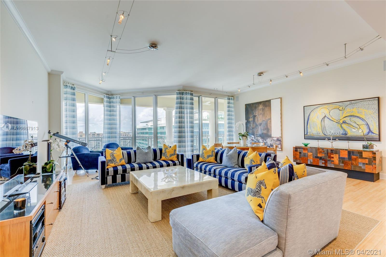 Come and enjoy the ocean and Miami skyline views from this unique 3 bedroom, and 4 full bathroom penthouse unit. The unit is highlighted by its incredible amount of space and access to natural light throughout. The penthouse features 12 foot ceilings- ideal for art collectors, vast closet space, a large living area perfect for entertaining. Recessed lighting, a sound system throughout, bamboo floors, equipped with Viking and Subzero appliances. Private elevator foyer with special glass doors to enjoy views of the Atlantic Ocean as soon as you enter. Condo has a plethora of amenities including an exercise room, heated pool, and private beach access. Great location, within walking distance to  restaurants and shops.