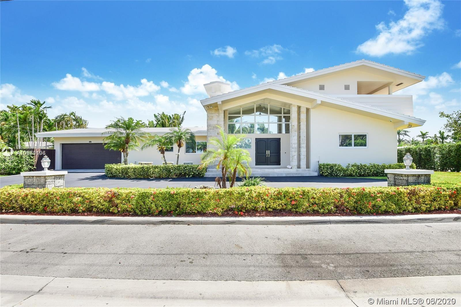 Bay Harbor Islands upgraded family home. 4-Bedroom / 4-Bathroom + 1/1 Maids quarters & Large 2-Car Garage. New porcelain floors, New Impact Windows & Doors along with plantation shutters throughout entire home. Huge eat-in kitchen, Large second floor master suite with balcony, open floor plan with cathedral ceilings, high-end security system, Smart Home, NEW (2) zone A/C, New exterior stucco and paint, relaxing Koi pond, Corner Lot with over-sized circular driveway, A-rated schools, New 7-person outdoor hot tub, new outdoor shower, enclosed yard with privacy fence, quiet street