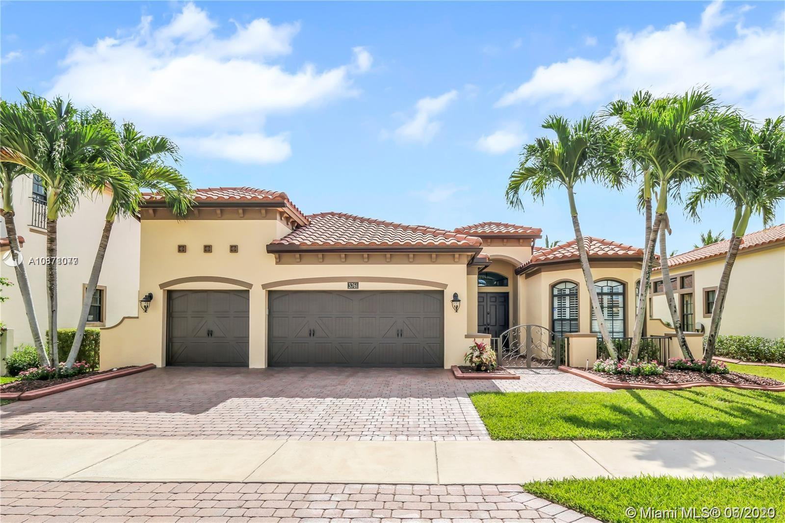 """DON'T MISS THIS TURNKEY LAKEFRONT BEAUTY! Largest Engle-built 1-story model in Cooper City's highly sought-after, family friendly + gated ESTADA community w/ 24/7 guard! High-impact glass windows/doors; keyless entry locks; 10-13' volume, coffered + tray ceilings; upgraded kitchen w/ double ovens, 42"""" custom cabs + large island; triple-split floorplan; master w/ sitting area, custom walk-in closets, floor-to-ceiling travertine in bath, dual walk-in shower w/ body sprays + jacuzzi tub; Bose surround sound ceiling speakers; bay windows; plantation shutters; 3-car garage w/ Premiere Garage flooring, cabs, grids, racks + overhead storage; ADT cell guard; internet, cable + ADT monitoring incl. in monthly HOA fees. New ACs in 2014 & 2018. Furniture are not included. Schedule a viewing today!"""