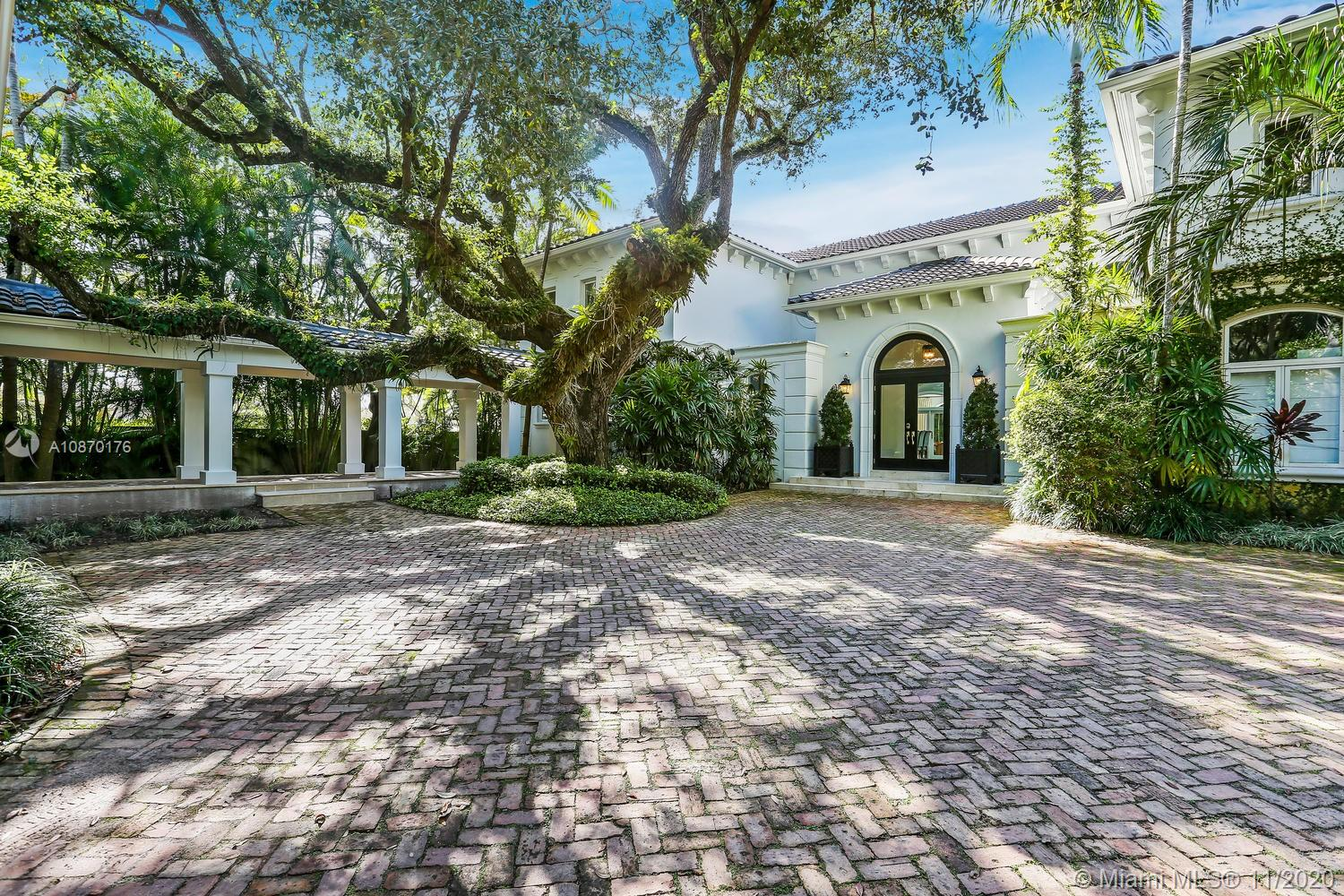 French contemporary, 100% redone, builder acre hidden in Gated Palms Estate on Cul-de-sac. Uniquely convenient & private. MOVE IN READY! NO HIDDEN COSTS. Generator pwr.6,800 sqft, 24ft vaulted ceilings, 3 seating areas. 5 bed/5.5 ensuite baths. Scavolini gourmet kitchen, herringbone floors, Subzero fridge/freezers, Gagganeau wine fridge & Wolf gas stove. Grandmaster with private lounge/HOME OFFICE,3 large walk-in closets & private exit to pool & garden. Great room, formal dining & living, family room. Entertainer's dream, impact glass, large outdoor entertainment. 500ft covered terrace, lounge area & marble deck.Outdoor kitchen, vast garden lined with Palms.Perfect for exclusive events. French lamp lite tree-lined private manicured access. Top schools, restaurants & shops.