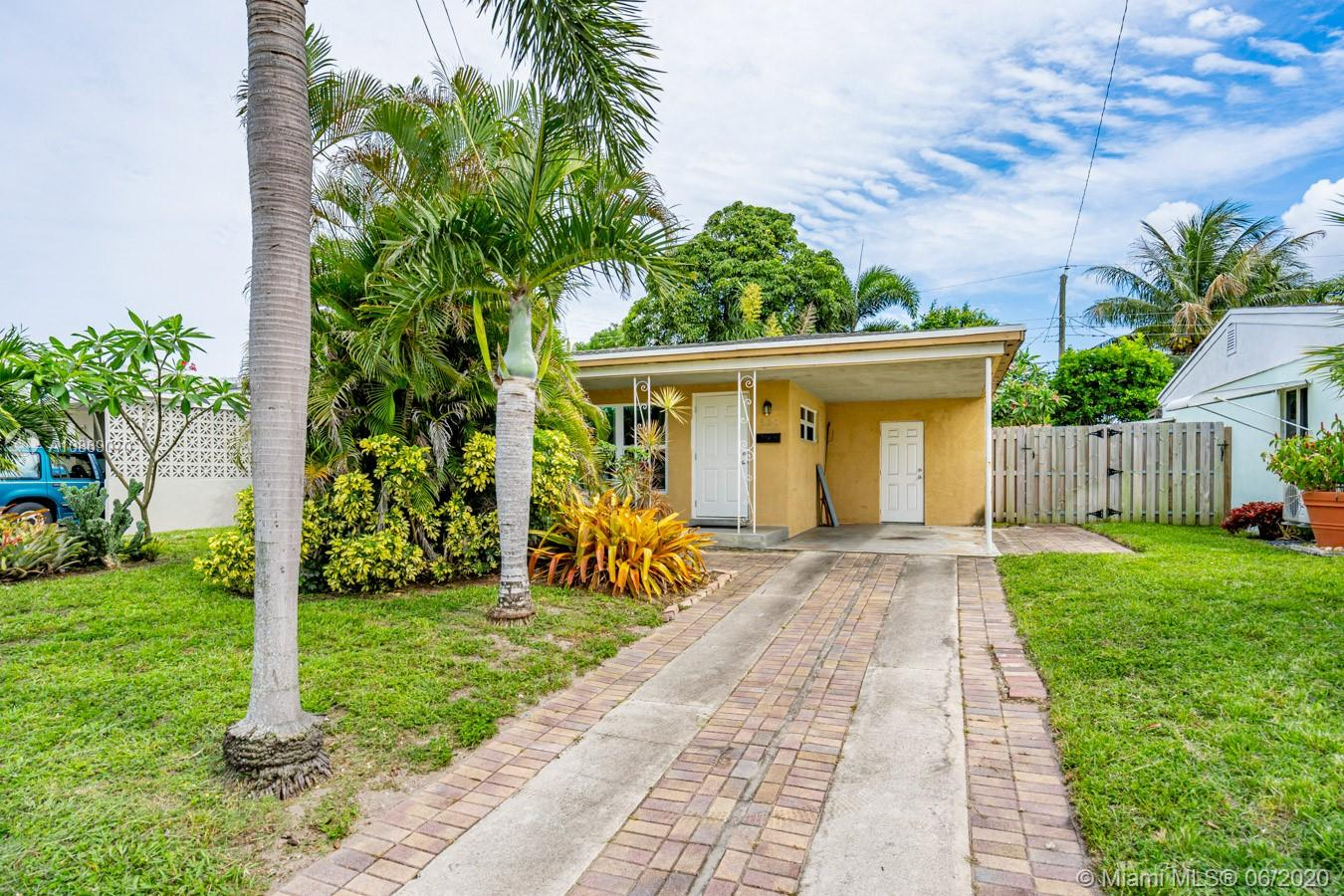 Charming 2/1 in Ft. Lauderdale is ready to move in! Property features hurricane impact windows, ceramic tile and wood floors, updated kitchen with new appliances, fenced yard, carport and so much more. Make this your home or investment today!