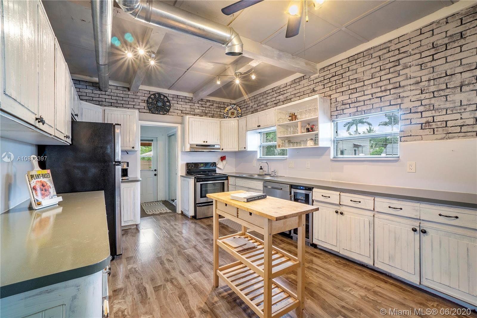 House Realty presents this 3 bed/1.5 bath Dania Beach home with creatively styled industrial modern finishes. The home features a spacious outdoor entertaining space, 2 workshop/storage additional structures. 10 min from the beach, minutes from I-95, 595 and Florida Turnpike.