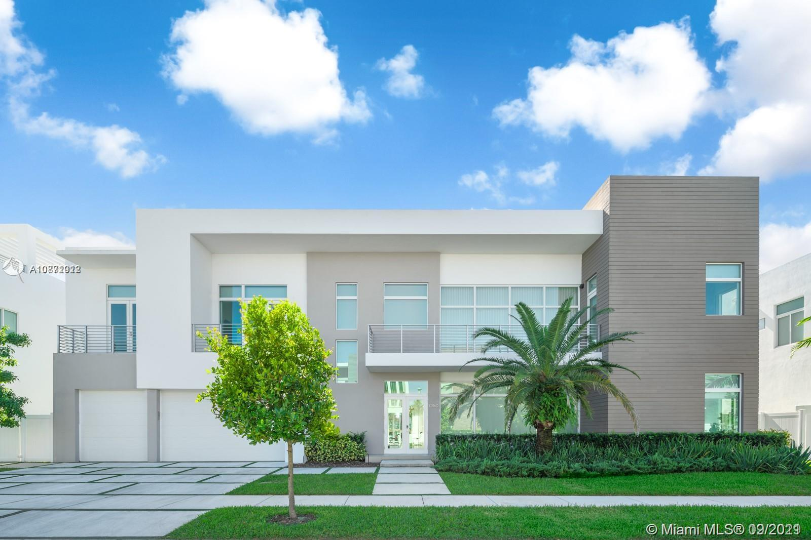 Unique opportunity to own the most stunning modern waterfront home at The Mansions At Doral. 8,560 Sf, 2 story, 6BA/6.5BR, 3CGl, on the only premium double size waterfront lot, w/ sophisticated finishes & upgrdes: double-height ceilings in living area, climate-controlled glass wine cellar, glass railings staircases, outdoors w/2 summer kitchens & 2nd floor 300 SF terrace w/panoramic views. 100% smart home: All lighting, speakers, shades, TVs, 13 surveillance cameras, & AC can be smartphone-controlled. Custom extended Italian kitchen w/Subzero/Wolf appliances. Master, w/balcony offers oversized glass shower/tub & boutique-style walk-in closet. Secondary BR suites w/walk-in closets. All Impact wndws.