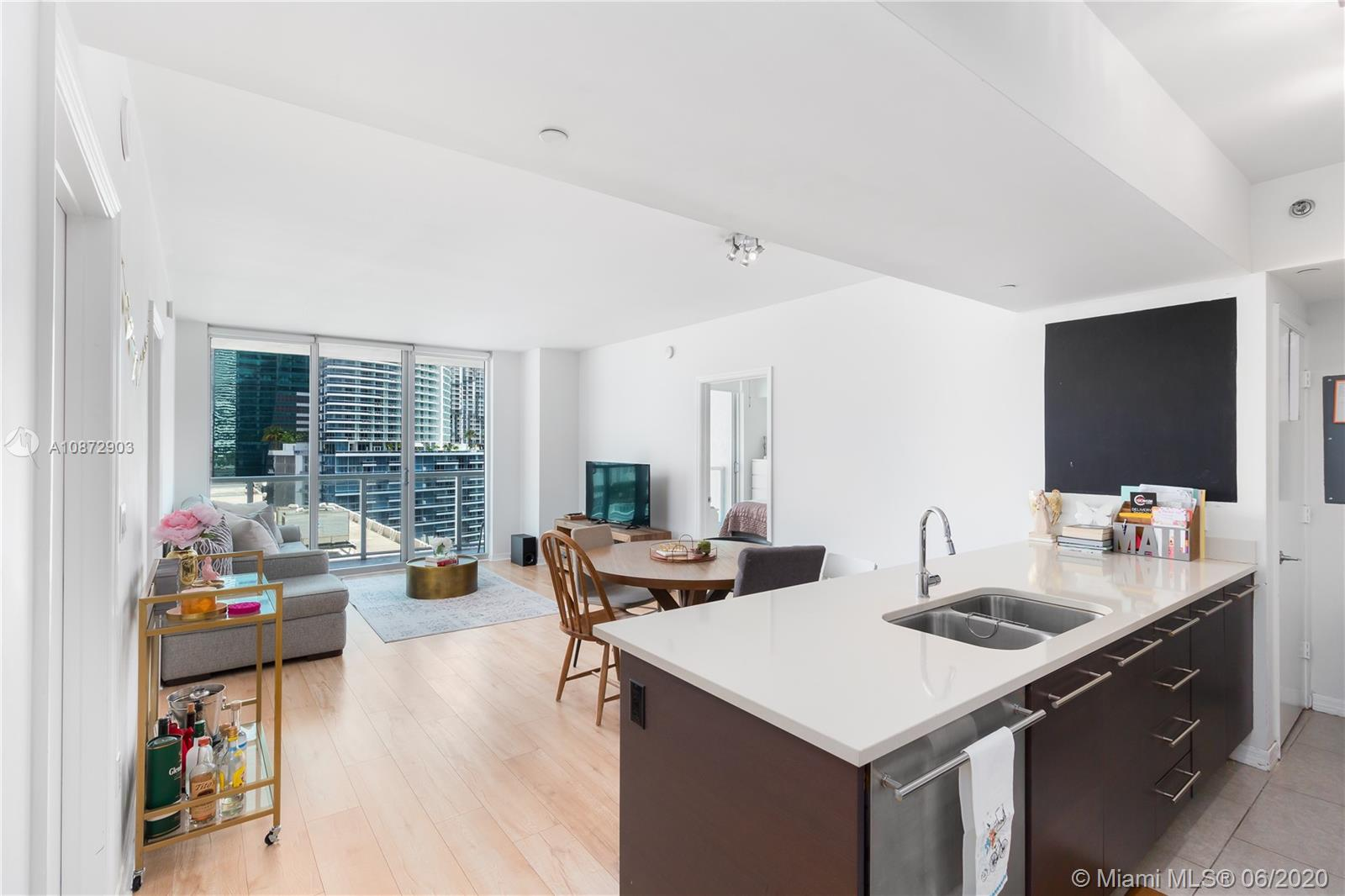 3D VIRTUAL TOUR (Link Below). Spectacular 2BR, 2Bath 1,124SF condo at 500 Brickell (East Tower) has direct North facing views & floor-to-ceiling sliding windows & direct balcony access from every room! Unit features a spacious split floor-plan, large bedrooms (BOTH with ensuite & walk-in closets); open concept kitchen, living/dining rooms, SS appliances, BRAND-NEW W/D (full size - front loading), BRAND-NEW AC UNIT, NEW top quality laminate wood floors. Outstanding amenities, including 24-hour concierge & valet parking, 2 Pools rooftop & sundeck on 11th floor w/poolside cabanas, fitness center, sauna & steam rooms, sports room w/billiards table & kitchen, wine cellar, club room & theater room. 3D VIRTUAL TOUR available!
