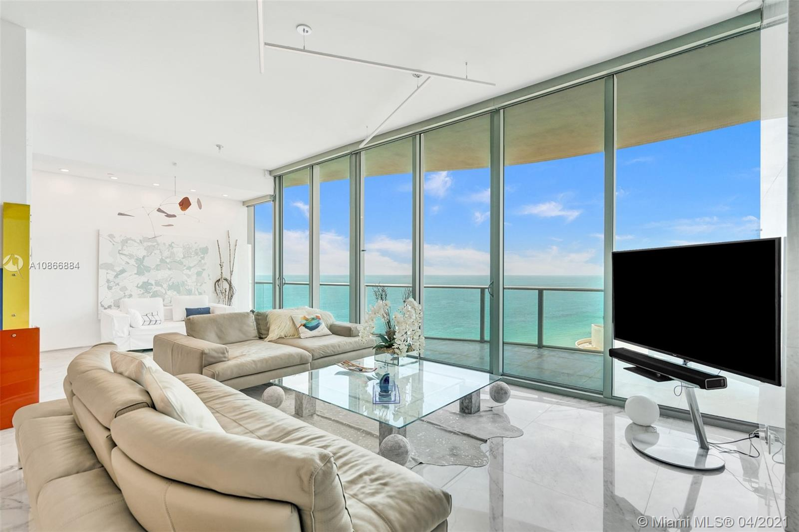 Incredible protected views from this spacious 25th floor 2 bed + Den condo in the heart of Sunny Isles Beach. 11ft high ceilings 3 marble bathrooms, Wind protected balcony, Maids room with full bathroom and service entrance, 3' x 3' white marble floors and columns,  Luxury master suite with interior glass walls. 29' of glass in living room, Electric window treatments, Stunning Ocean, City and Park views! Designer unit! Feels a lot bigger inside than the Sq Ft shown. Must be seen!  Chateau Beach is a quiet, elegant, exclusive building offering luxury & lifestyle w/ 5 Star amenities including a relaxation room w/ aromatherapy jacuzzi, Beach & Pool towel and food service, cigar room, home theatre, wine lounge, Breakfast bar, full time Concierge desk and much more.