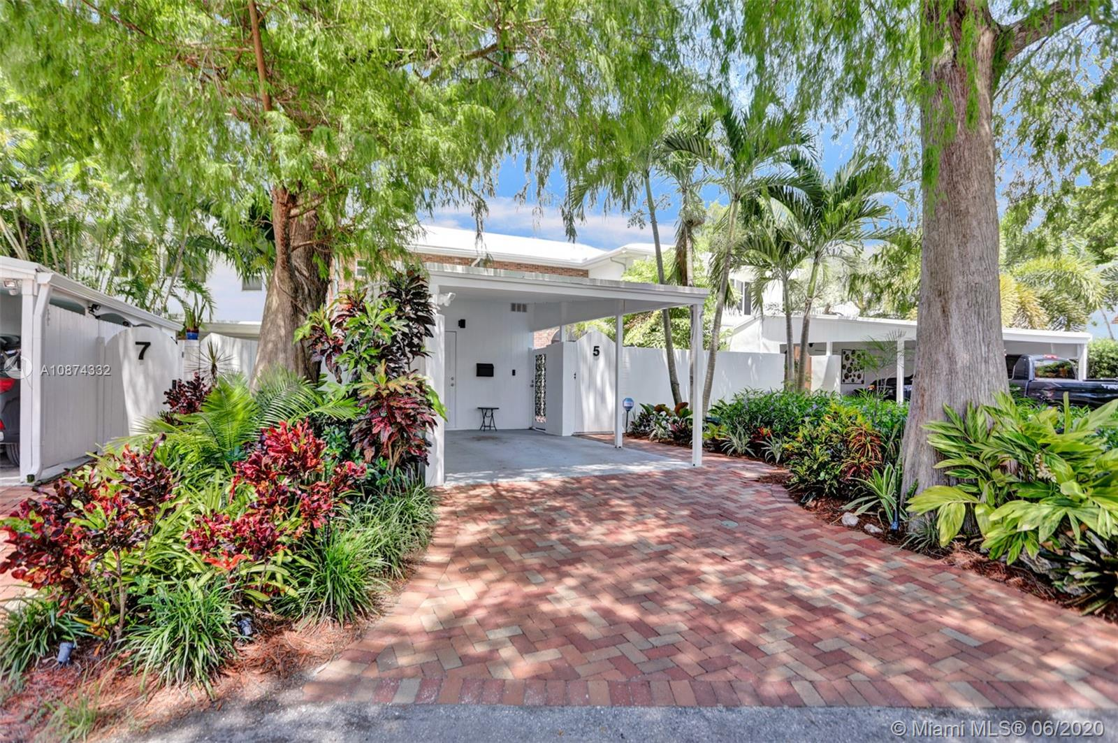 Rare Mid-Century modern townhouse in Wilton Manors.  A unique 1/1.5 with a private oversized gated courtyard with all the finest updates.  Brand new kitchen, custom modern cabinets, quartz countertop, whirlpool appliances.  LED lighting throughout, modern fixtures, custom blinds, impact windows & doors, new tile flooring on first floor and refinished wood stairs.  Master bath remodeled with extra large shower,  sleek new vanities in both bathrooms. Large master bedroom with walk-in closet.  Interior and Exterior freshly painted.  Pavered courtyard has new faux boxwood fencing.  Brand New A/C unit, New Water Main Line, Resealed roof, Termite Warranty, and Ring Security System. Low-maintenance, move in ready. All nestled in a quiet location of Wilton Manors but walkable to The Drive.