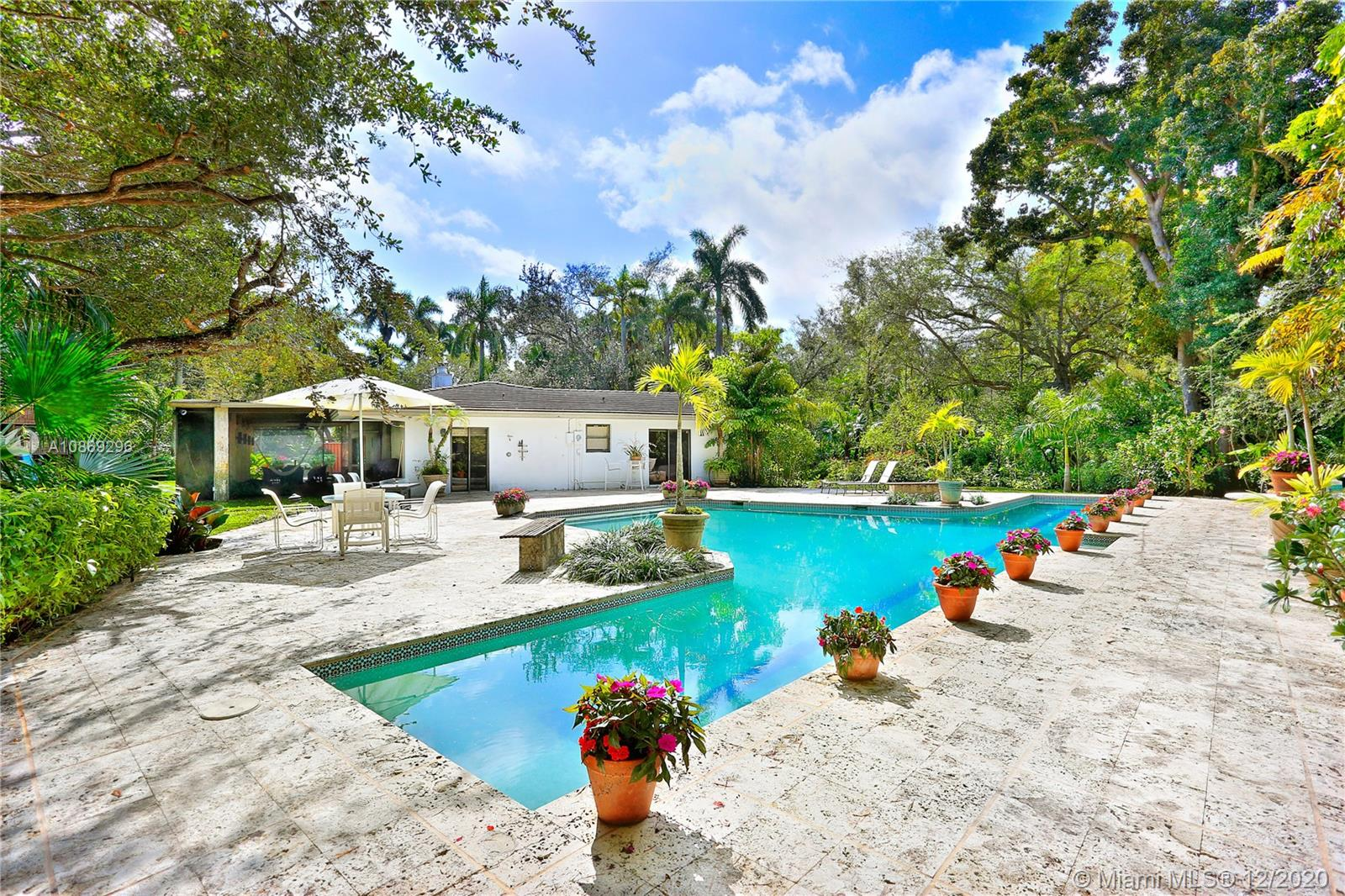 Exciting opportunity to design and build your dream home in the newly approved gated community with private security, Hammock Lakes II. This generous 31,799 sf lot is tucked away and perfect for those who seek exclusivity and enjoy restful ambiance and sophistication. Located in a family friendly Coral Gables neighborhood just minutes from A+ rated public and private schools, parks with biking trails, and a wide variety of dining pleasures and boutique shops. Your ideal lifestyle awaits. Charming existing home is surrounded by mature trees, lush landscaping, and features a pool, fireplace and 2 car garage.