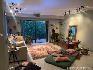 Key Biscayne condo in Boutique building waiting for you! Like being on vacation everyday.Large split plan unit 2/2, large balcony, Laundry room in unit washer/dryer. Crown moldings, 24 x 24 tile floors, renovated bathrooms, walk in closets.  Personal storage closet in hallway.Walking distance to the Beach, the Village and Community Center.  Balcony overlooks a line of trees. Very tranquil. Great schools. Enjoy the good life on Key Biscayne.