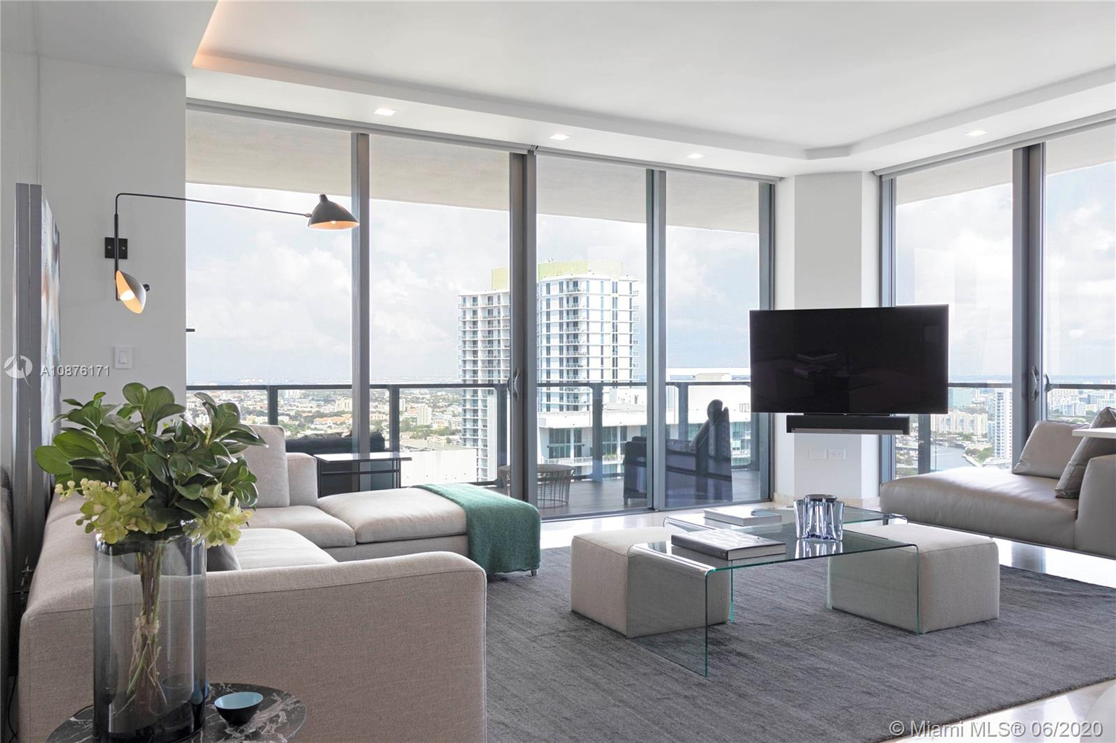 High floor, Rise corner unit with expansive wrap around balconies. Interior Design by Nar Design Studio with a unique remodeled layout including enlarged living room, upgraded frameless doors, closets, custom lighting design, integrated smart home system with Ipad/smart phone and voice control for electric shades, A/C, Sound system and lighting. This is one of the few corner line units with expansive wrap around balconies. One acre of lush tropical gardens with meditating area, BBQ grill, children's play area, heated pool/spa, spacious state of the art fitness center with individual studios and machine rooms. Hammam spa, dipping pools, showers and steam rooms. Entertaining suite elegantly furnished chef-worthy kitchen, dining, living room, theatre room and much more.