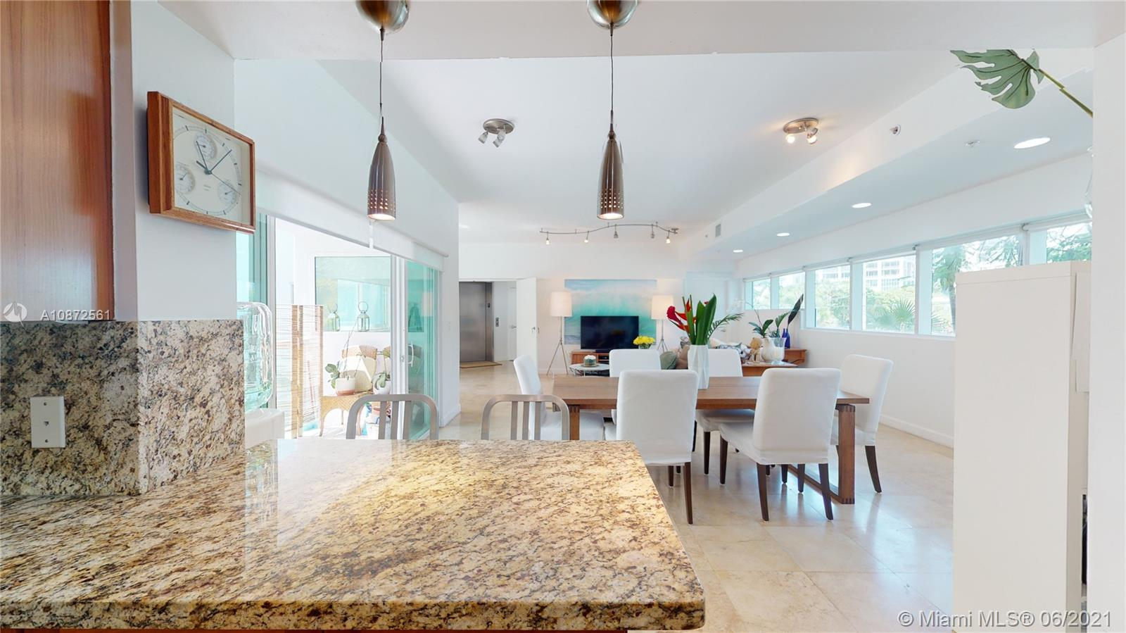 Welcome Home to a Boutique Condo with an elevator shared with only 7 other units that allows 3 pets (BIG DOGS INCLUDED) in the heart of Coconut Grove!  Only 20 units in entire building!  Marble floors, Granite Counter tops throughout, Stainless Steel Appliances, Steam Shower, Whirlpool Tub, Large Master Bedroom, All Walk-In Closets. Just 3 blocks from CocoWalk and 1 block from Fresh Market!  Grill out on the Roof with Gorgeous Views, a Perfect place to watch the fireworks on July 4th!  Key-Fob Elevator opens directly into foyer of unit!  Very secure!!  Impact windows/Doors.   Party room, Gym, Pool, and Secure, Gated Parking!  Also makes for a Great Investment Opportunity-currently rented and tenant is interested in renewing although renter can move out as well, if so desired.