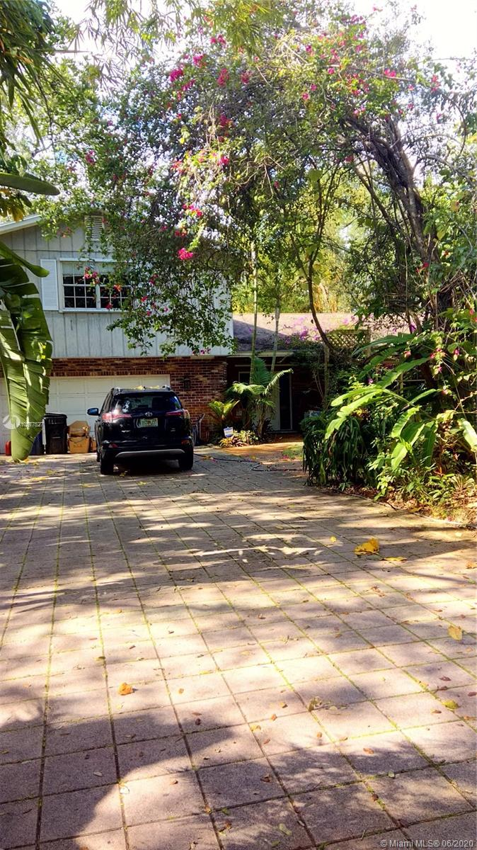 Tropical Florida at its finest. Classic 4 Bedroom 3 bath home in Beautiful Riverland. Extra large rooms, Fireplace, Fabulous, Florida Room with wet bar, gas grill and room for entertaining large groups of family and friends.The eat in kitchen is equipted with a top of the line gas stove, custom cabinets and pass through window to the oversized florida room.  This house has Great Bones, needs some TLC to make it your forever home.Riverland is a much desired area, it is a beautiful family community, fun, friendly and quiet. Beautiful homes, close to the water, with boat launch just down the street.  Close to all highways, 595, 75 and I95 minutes away. Airport is less than 20 minutes and the new Hard Rock Guitar Hotel is less than 5 miles.