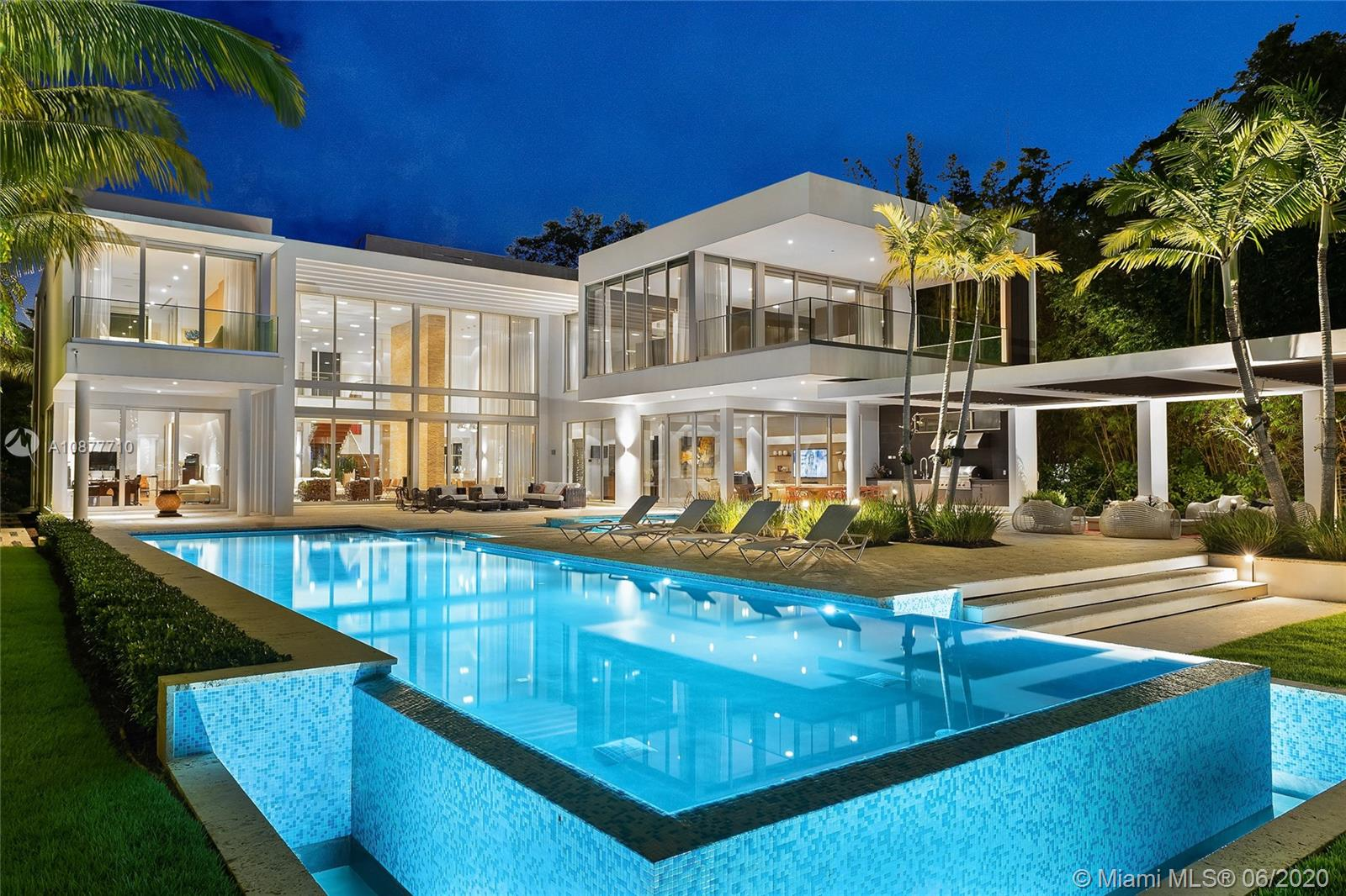 This modern 2-story estate on guard-gated Palm Island was magnificently redesigned and sits on a manicured 32,000 SF lot w/100' of waterfront & 13,144 total SF. The home features 9BR/8+1BA, soaring ceilings, rich hardwood floors & expansive living, dining & family areas all with stunning water and city views. A gourmet kitchen sports top-of-the line appliances, a family room, a movie theater, elevator, pet room, 4-car garage, staff rooms, recreation room and a full gym. The 2nd floor principal suite is spacious w/views to the pool, dual walk-in closets and beautiful Carrara marble bathroom. Outdoor features include a large pool w/Jacuzzi, covered seating area with summer kitchen, an IPE wood dock & direct access to Biscayne Bay & the Ocean. Amazing design and unequalled amenities.