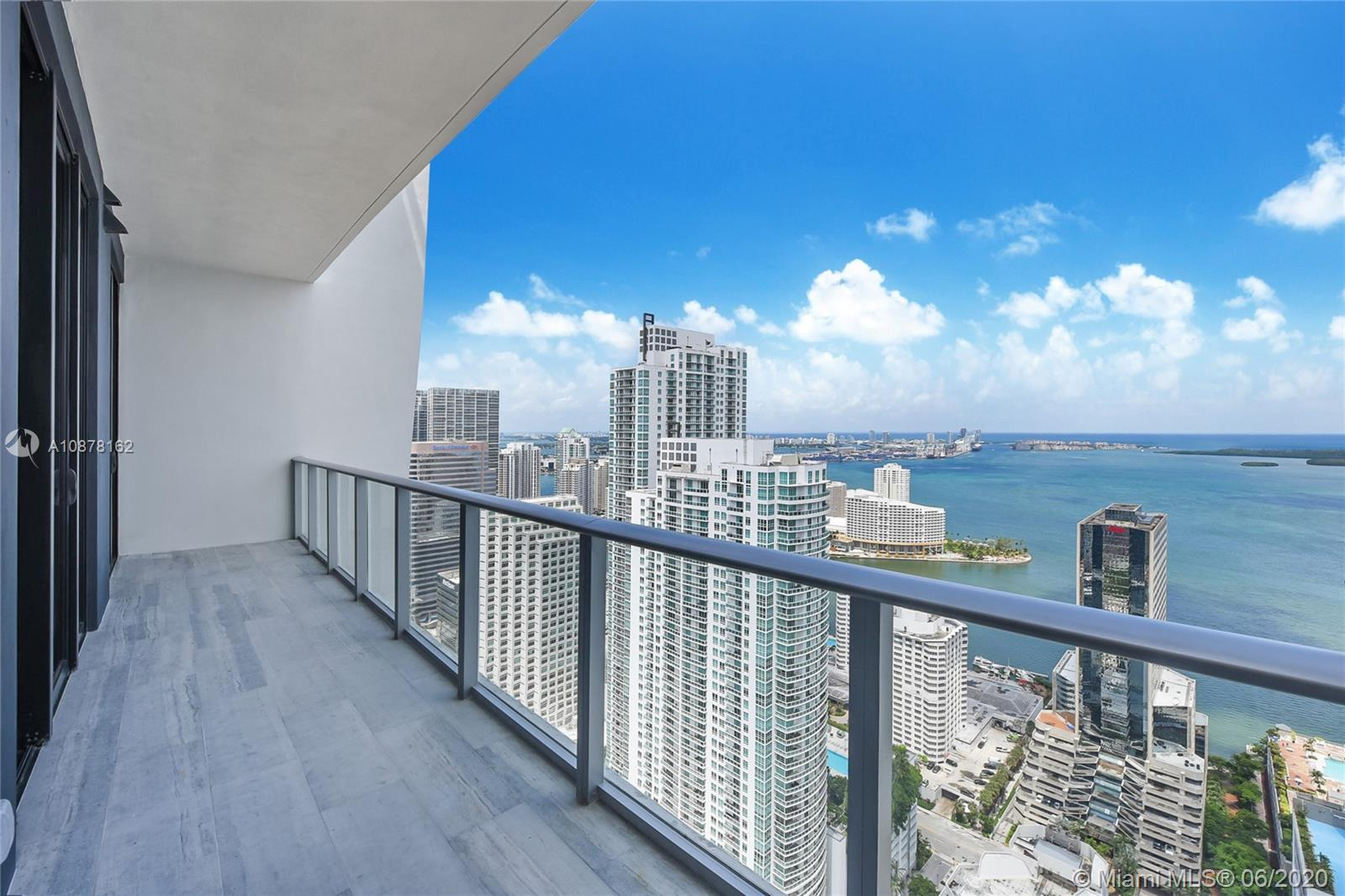 Lower penthouse in the most sough-after new building in Brickell. Unit has 12 feet ceilings, unobstrocted Biscayne Bay views, 2 bedrooms plus a big den, 3 full bathrooms and elevator opens directly to the unit. Completely finished with Opustone Alzata marble floors, custom made closets in all bedrooms, custom made electrical shades and top of the line appliances.  Unit is currently rented until May 2, 2021 at $4,250 monthly. Upgrades throughout.
