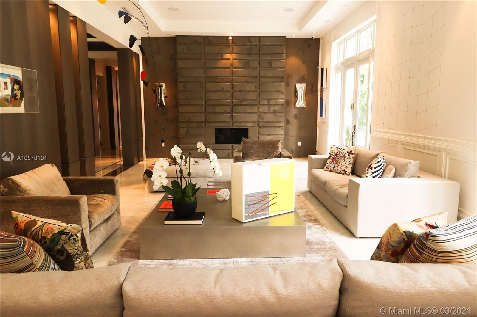 Colonial Estate in the Ponce Davis, This beautiful 8 Bedroom residence was being constructed by the award winning Greg an Construction. Living area SF 10,591.  This palatial home will include a Elevator, Teather with vine cooler, with pool, big yard, complete update, with a modern decoration.(complete-furnish)and many other wonderful details! ! Easy to show!