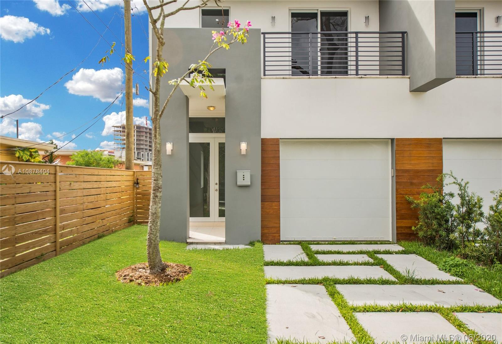 "Tropical Modern, new construction townhome in a quiet neighborhood just minutes from Coconut Grove, Coral Gables, MIA, downtown & Brickell. Light-filled open living spaces with volume ceilings, 32"" x 32"" porcelain tile & solid wood flooring, LED lighting and impact glass throughout. Custom kitchen featuring wood cabinetry, stone countertops & black stainless LG appliances, opens to family room. 3BR/3.5BA, including large master suite with balcony & spa-like master bath w/ Jacuzzi tub. Enjoy year-round entertaining on private outdoor terrace with tropical pool. 1 CG. Close to major expressways for easy access throughout South Florida. (Please request via showing time)"