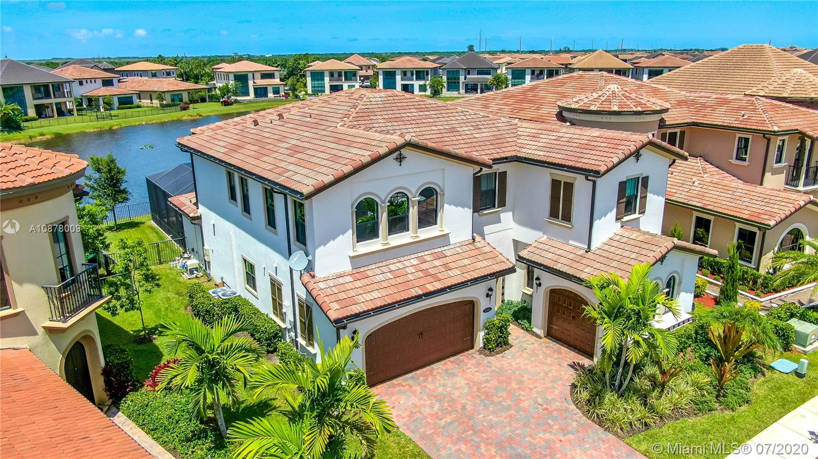 Estate in highly desired WaterCrest Parkland, built in 2017. Soaring 16' ceilings await in entering the living room. Sprawling water views along zero-entry chlorinated saltwater heated pool w/water features, surrounded by sunscreen enclosure. Impact windows & doors, 3CG, 4 BR, 5 BA, large office. Master suite is complete with a screened balcony, 2 walk-in closets, and a luxurious jetted bathtub. Walk-in shower the size of a hallway, a must-see!! Custom closets and walk-in pantry. Elegant wood staircase extends to a huge loft. Expensive gourmet kitchen, high-end appliances, cabinet lighting & massive center island. Home boasts intercom, alarm system, cameras, surround sound indoors and on patio, outdoor kitchen, & tv on the lanai. Porcelain tile and wood flooring, over $300,000 in upgrades.