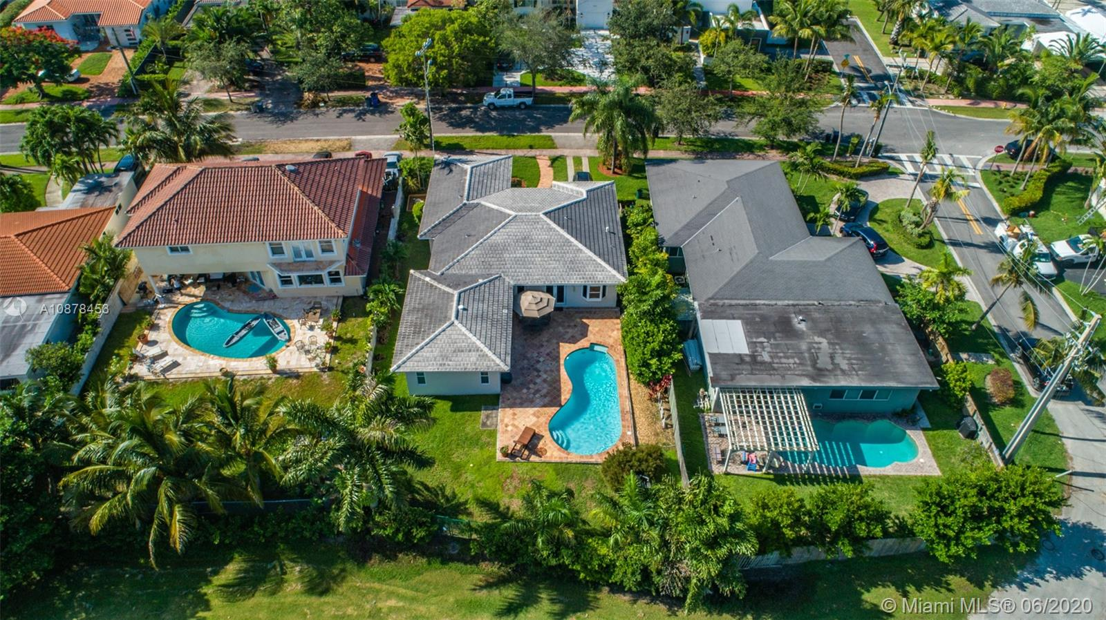 Enjoy living on this guard- gated island with an 18-hole golf course, bayfront tennis courts, sidewalk lined streets and children's playground. This home is over 2,200 SF and is impeccably maintained with tremendous natural light, impact windows and open floorplan ideal for entertaining. The en-suite master bedroom is large and leads out to the pool. This home is extremely private, as the backyard sits on  the lush golf course. Normandy Island is ideally located just minutes from the beaches, upscale shopping, finest restaurants, nightlife, Bal Harbour, South Beach, downtown Miami, airport and houses of worship. It is a must see…