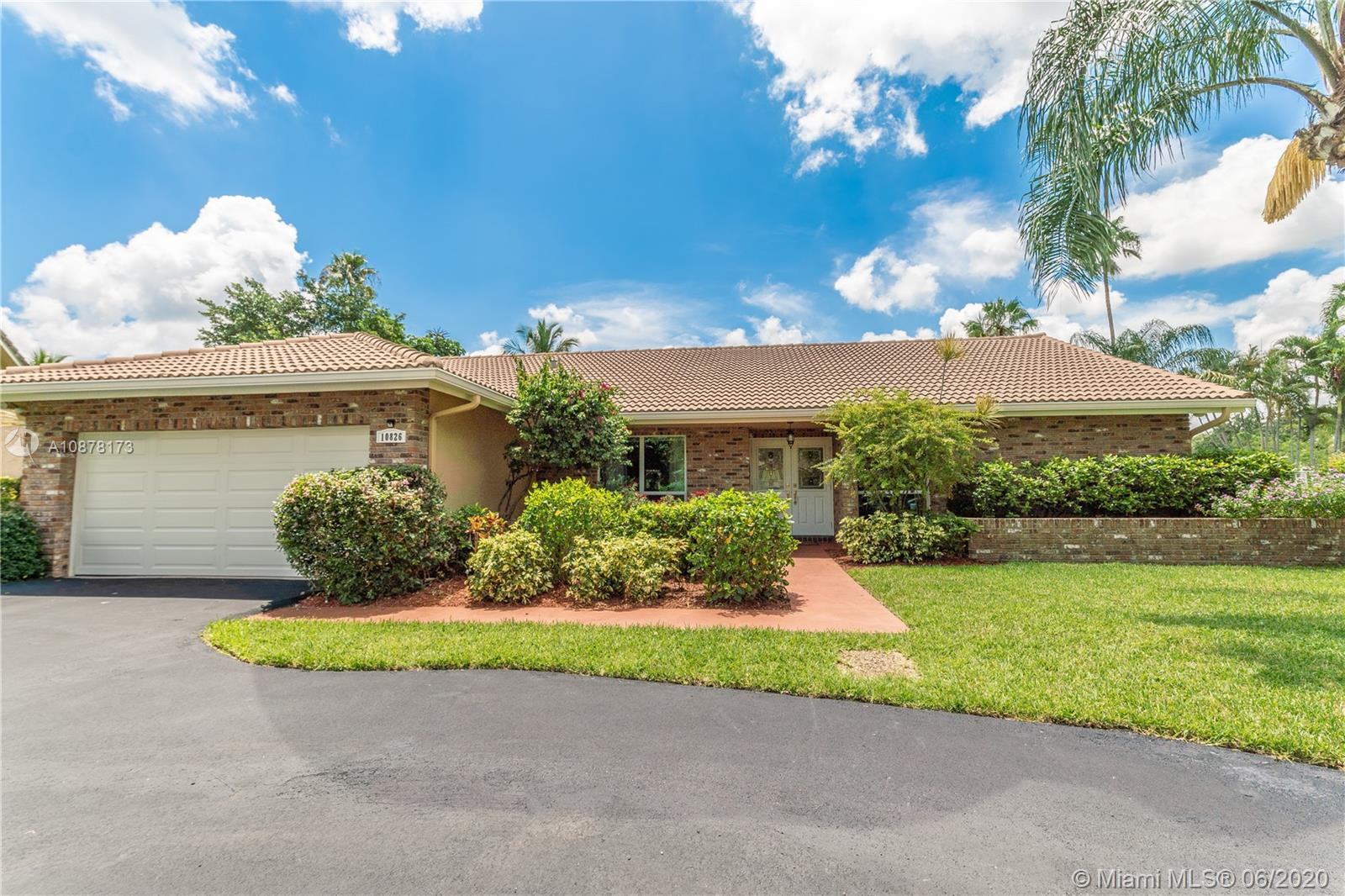**Stunning 4/2.5 plus Den Pool Home on Oversize Waterfront Lot in the Heart of Coral Springs. Breathtaking Travertine floors throughout common areas and bathroom. All bedrooms are porcelain Upgraded Kitchen complete with Quartz countertops, designer cabinets, and stainless steel appliances. Remodeled bathrooms, desirable split floorplan, Hurricane impact windows and doors throughout. Enjoy spacious covered screened in patio overlooking sparkling pool with serene water views. Den can be easily converted into 5th bedroom if needed. It has been well maintained and kept in immaculate condition. This home is immaculate and displays true pride of ownership.