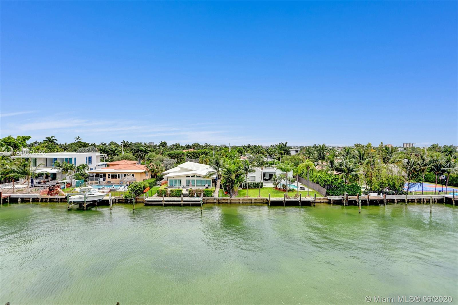 Fabulous opportunity to own a bright and spacious two bedroom, two and one-half bath unit with direct water views in Bay Harbor Islands. Large ample areas all offer views to the water, tile floors and a long balcony. A washer and dryer come with the unit, as do two assigned parking spaces. You'll find many amenities in this doorman building including a pool, boat dockage, an exercise room and more. Steps of fine dining, parks, top rated schools, beaches and the famous Bal Harbour Shops make this a prime location. Enjoy the Miami sunset from the comfort of your balcony!