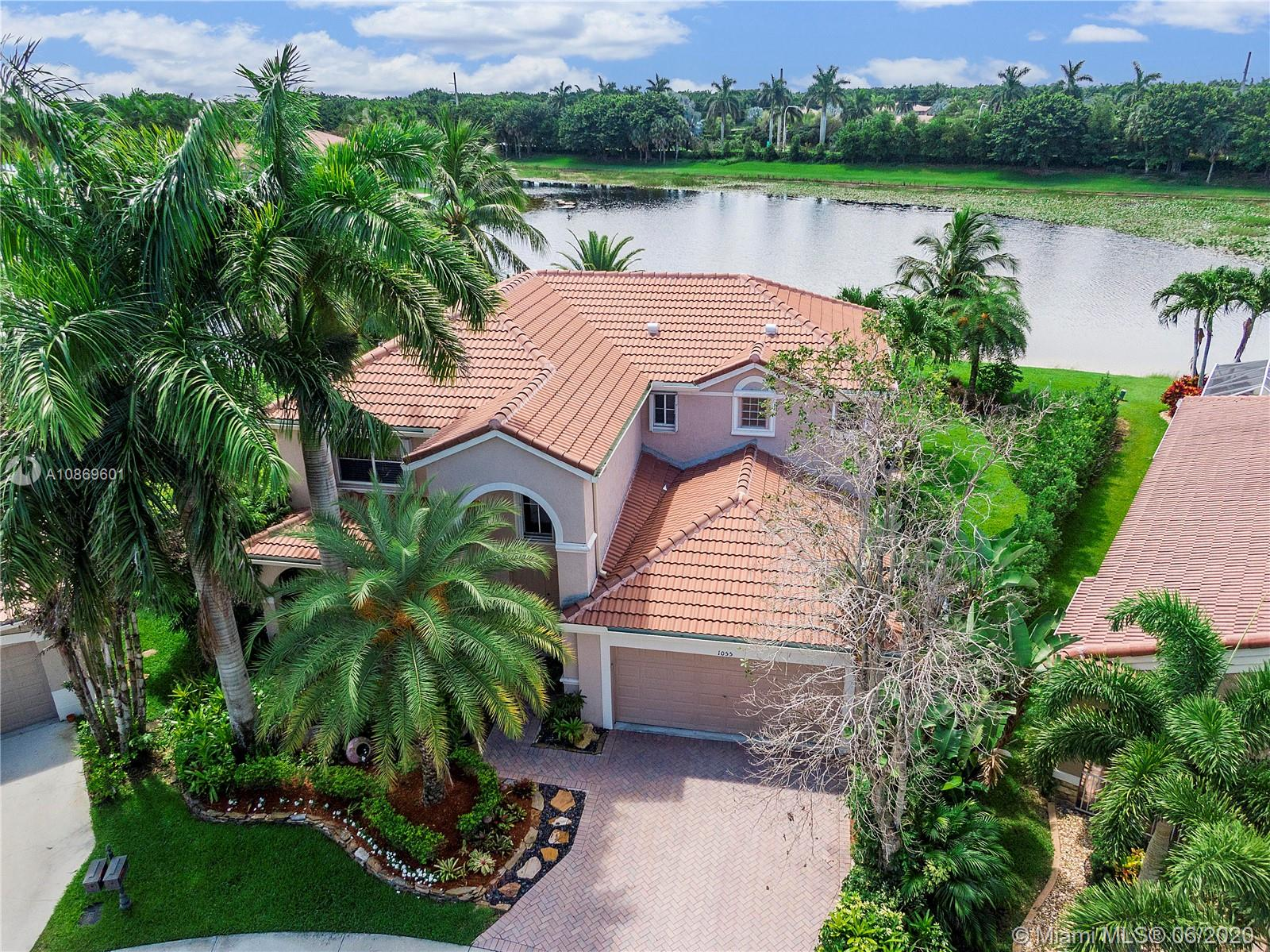 Wow! Beautiful Tropical Oasis Paradise W/Long Lake Views.  5 Bed / 4 Bath Home W/2 Car Garage On A Pie Shaped Waterfront Lot Located On A Cul De Sac In The Heart Of Weston. NEW Roof 2020. Home Features Open Layout. Granite Custom Kitchen With Stainless Steel Appliances, Wood Cabinets, Breakfast Bar, Built-In Nook, And Pantry. Master Suite Has His & Her Custom Closets & Natural Lighting. Stunning Master Bath Has Barn Door Entry, His & Her Wood Vanities W/Marble Counters, Upgraded Lighting, Frameless Double Shower, & Designer Tub. 1 Bed and Bath Downstairs. Custom Staircase W/Rod Iron Railings, Crown Molding,. (2) Newer AC Units W/ Nest Thermostats. Tile And Hard Wood Flooring. Impact Oversized Tropical Yard Features Covered Patio, Lake, Lush Landscaping For Privacy And More. Must See!