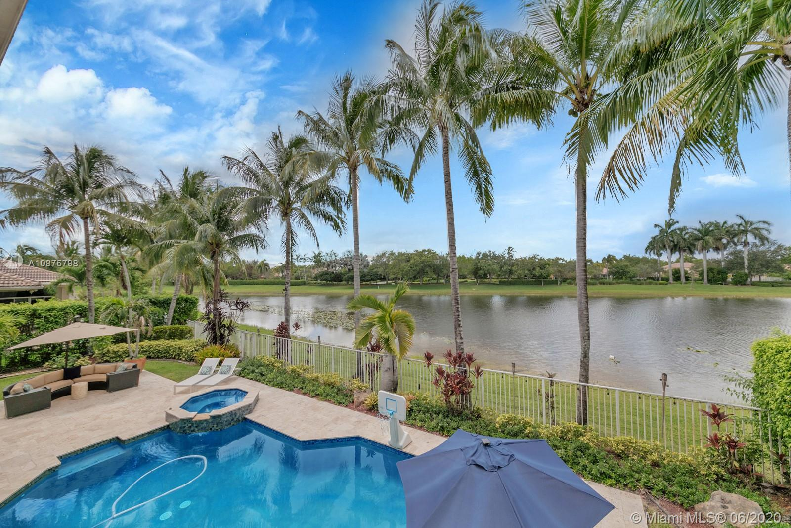 WoW! Big, Bold & Beautiful! Tastefully updated with a contemporary flair, this lakefront home is perfect for enjoying the Florida lifestyle. 5 bedrooms, 5.5 bathrooms + office, 20x14 playroom and loft spans 5365 sq ft (inclusive of 1/1 guest house). Grand entry with volume ceiling and elegant custom staircase welcome you home! Center island kitchen w/breakfast nook overlooks the family room. Luxurious master wing w/sitting area features 300 sq ft balcony allowing you to experience breathtaking sunsets from your private suite. The resort-style backyard features a travertine marble patio and summer kitchen w/built in grill+Argentinian BBQ, perfect for outdoor chef. Heated and salt freeform pool+spa is surrounded by lush tropical landscaping. Guard gated community w/pools, ballfields etc.