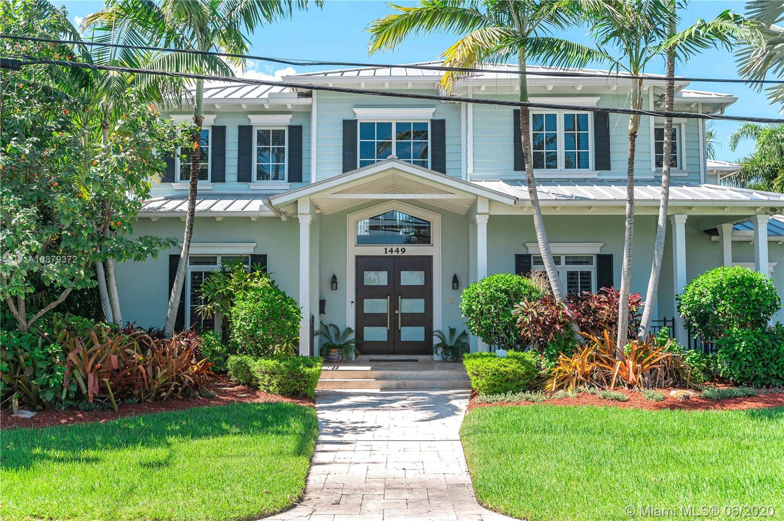 Live the Key West Style in Lauderdale Harbors.This open floorplan 4 Bed 4 Bath brings The Keys to Fort Lauderdale. Soring 20 foot wood coffered living room ceiling with wood burning fireplace,Step-down wet bar w/ ice maker,a wall of Windows overlooking 80 foot waterfront concrete seawall. Impact windows and doors throughout and three car garage.Situated on Large turning basin with direct ocean access. Large open kitchen featuring Sub-Zero Refrigerator, GE Monogram Double oven, warming drawer, cooktop on granite top island and Wine refrigerator.  Counter space and cabinet space is ample with walk-in pantry. Master Suite features Wood Ceiling, seating area, three walk-in closets dressing area plus covered 25 foot balcony overlooking downtown. Roman tub and walk-in shower complete the suite.