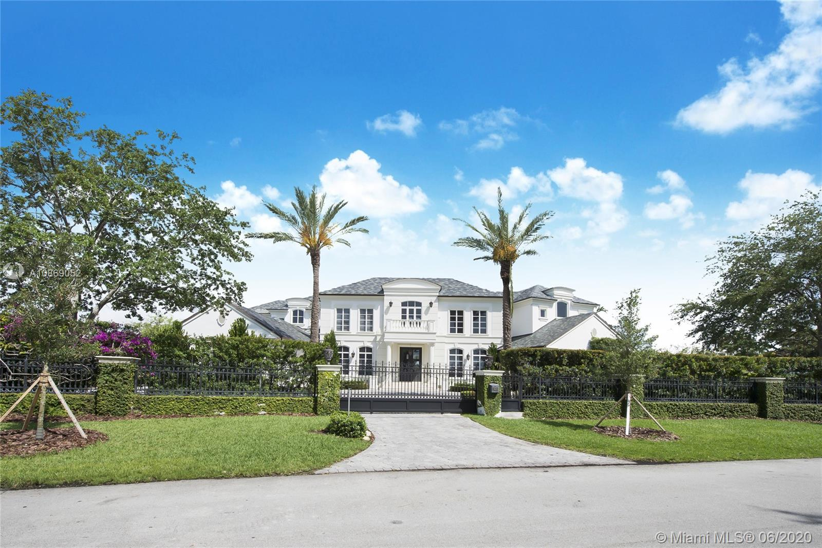 Glamorous estate, remodeled in 2015, offers every modern luxury. Over 170' of waterfront; 100 foot dock; wrap-around lagoon views; no bridges to bay. Designed by famed architect Ramon Pacheco in highly desirable gated Old Cutler Bay. Abundant covered terraces and courtyard with water views. Spectacular soaring entry. Magnificent sweeping stair. Formal dining gallery. Custom finishes & fixtures. Full-home generator and surge protection system. In-home theater; 3 guest suites; staff quarters; 4-car garage. Infinity-edge pool.