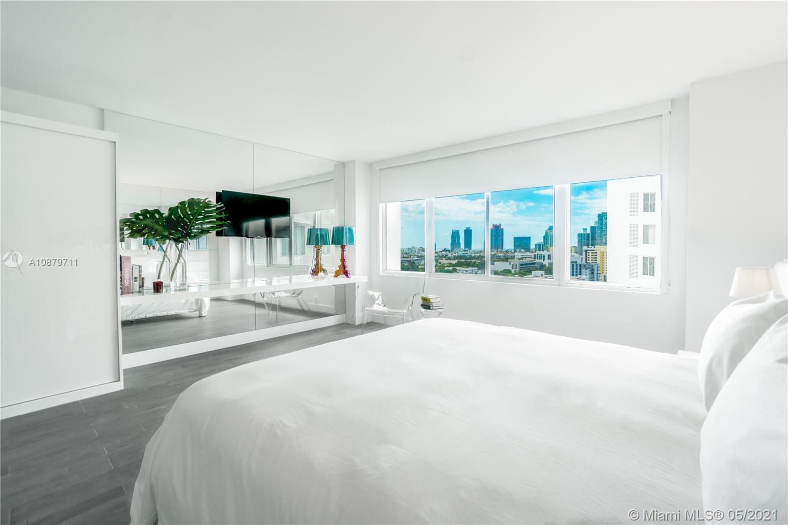 Sobe lifestyle! A stunning and remodeled spacious studio on the 14th floor with beautiful views of South Pointe/South Beach. New kitchen and luxurious bathroom in one of the most trendy buildings. Not part of the hotel program; offering a wide range of rental and personal use possibilities. Great value! Fully furnished and redesigned to maximize space and set a new trend in a building with all units alike. Newer A/C, water & electric included w/association. Be part of the exclusive area of South Beach enjoying 5-star dining, 24 hr room service, Sunset Lounge, 2 swimming pools, fitness center, spa, and 24 hr valet parking included and Exclusive Access to The Delano Beach Club. Easy to show!