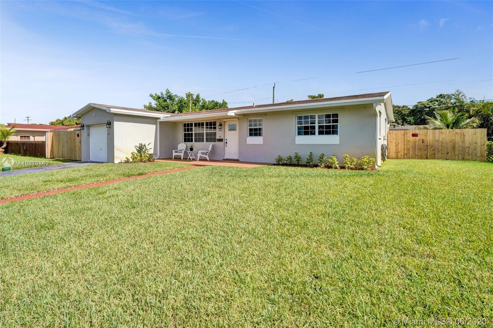 Interior has been completely remodeled less than 2 years ago. New kitchen, new floor, completely painted, new fence, remodeled bathrooms, hurricane protection, and more! Just steps away from Pembroke Pines Elementary School. Must see home!