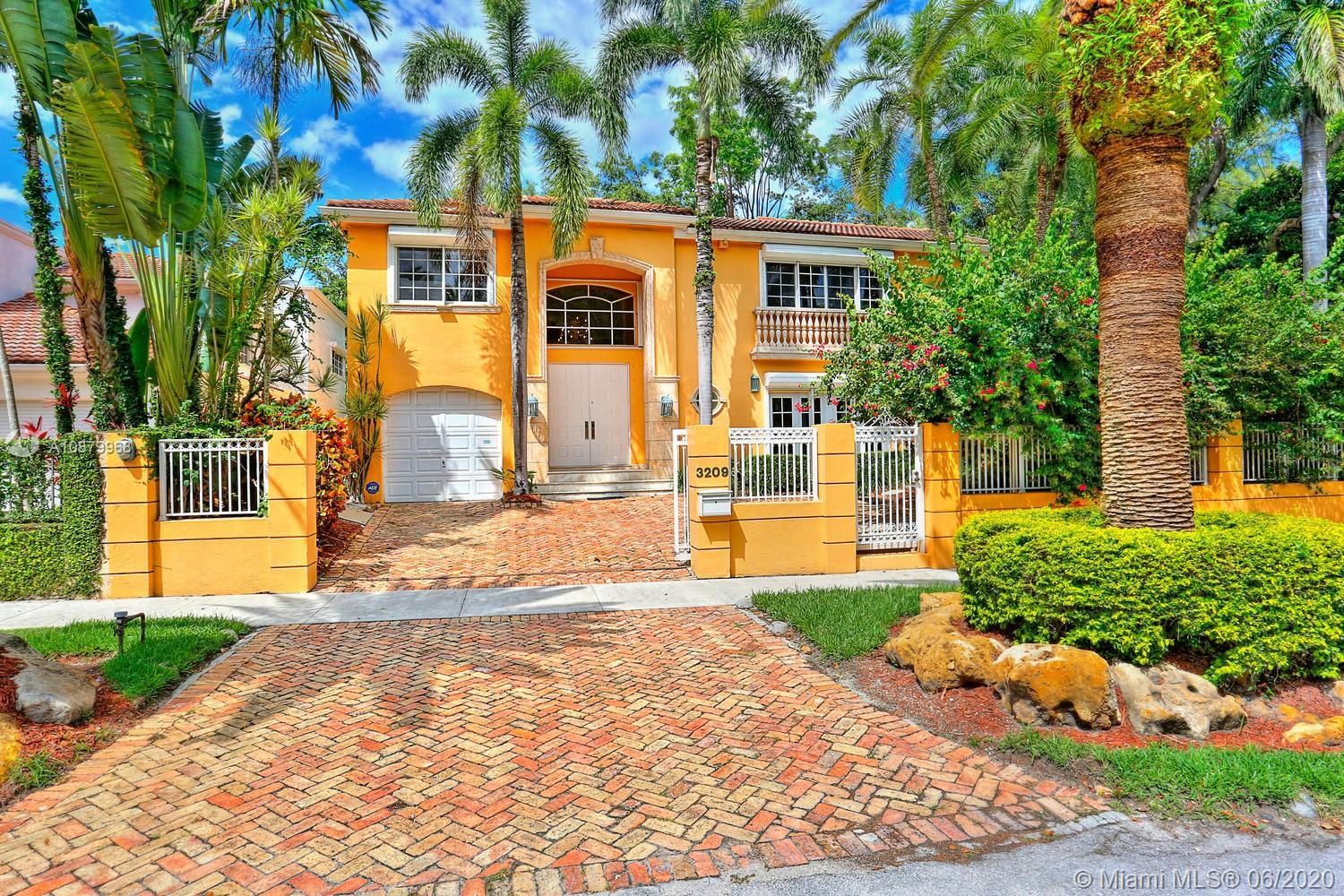 Lovely European-style villa in prestigious North Coconut Grove. Walk to bayfront parks & marinas, yet not in a flood-zone (located at one of the highest sea-level elevations in South Florida). Walled & gated residence with light-filled living spaces, volume ceilings, marble flooring & stunning staircase with modern glass railing. Formal living, dining and expansive family room. Custom kitchen features wood cabinetry, granite countertops, all new appliances & separate breakfast area. Expansive master suite & luxurious marble bath with frameless glass shower & soaking tub. French doors open to ultra-private, lush tropical garden with ample room to add a pool. Close to the Grove village center's boutiques & cafes and minutes to downtown, Brickell, MIA, Key Biscayne and the Beaches.