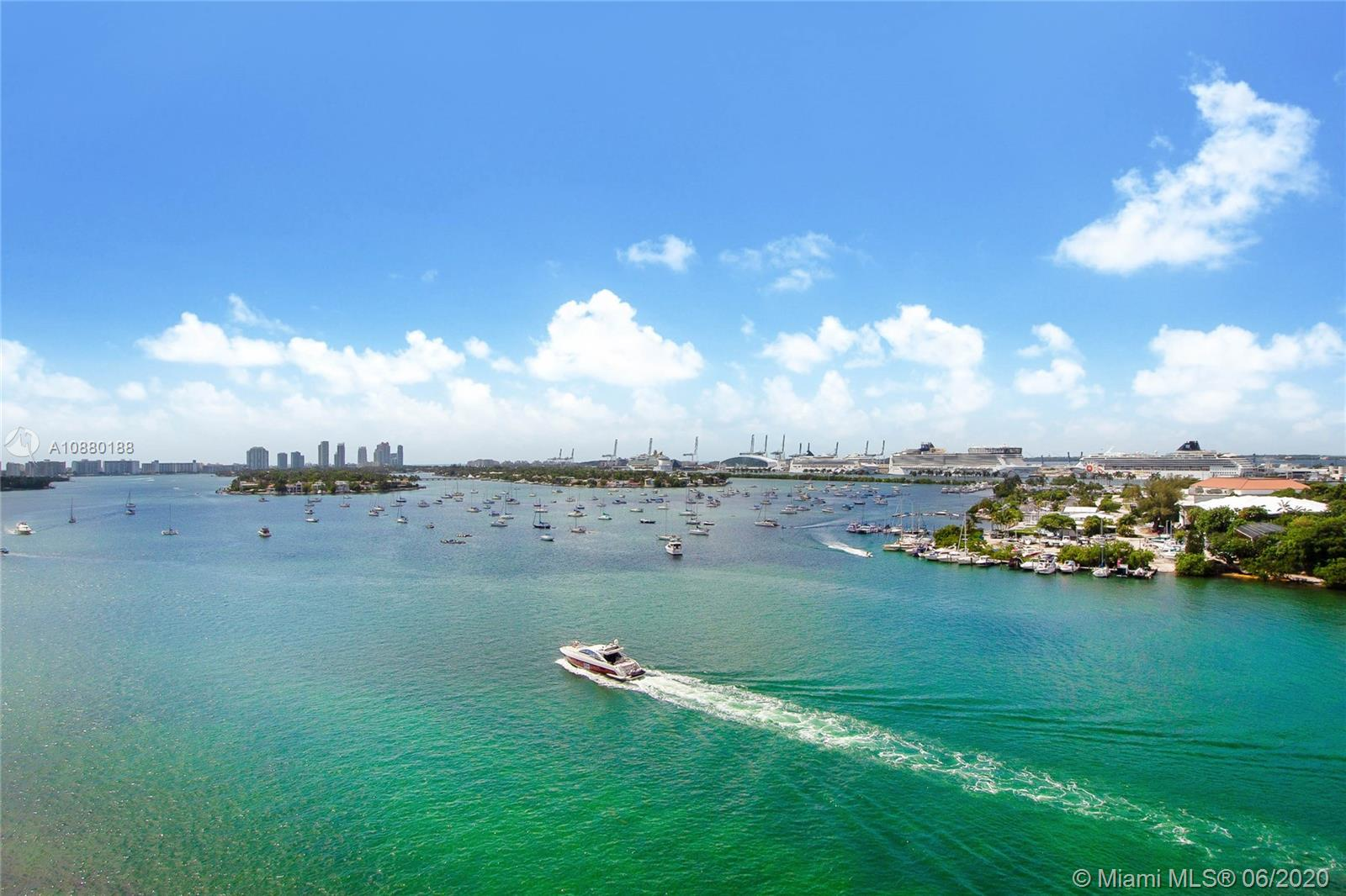 Panoramic views of Biscayne Bay & the Miami skyline await you in this corner unit with stunning north, east & south views. The unique living area has three walls of 9' floor-to-ceiling, hurricane-proof impact glass opening onto a 1,000SF of U-shaped terrace, creating a dynamic home perfect for entertaining. This 2bed/2bath (1,830SF) home seamlessly blends interior and exterior living spaces with all rooms having direct access to the oversized terrace and the most spectacular views in town! 2 assigned parking spaces and easy to show.