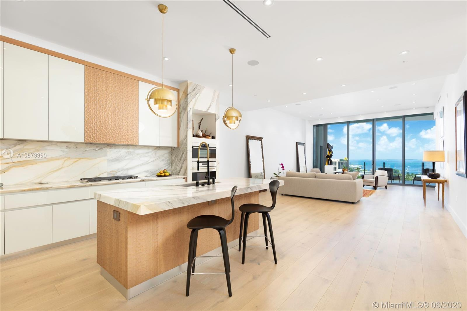 One of a kind custom floor plan and design at Two Park Grove #9B. Finest finishes and details throughout. Spectacular wide-open spaces with dramatic water views of Biscayne Bay and Regatta Park from the 12' floor-to-ceiling windows and 393 SF waterfront terrace. European White Oak wide-plank wood floors throughout, with Shell Stone marble floors and walls in the master bath. ITALKRAFT kitchen with custom cabinetry, Wolf gas range, oven, steamer, built-in coffee maker and Subzero refrigerator. 85 LED lights, ceiling speakers, electric shades, and smart home system. 5-star amenities including 24-hour concierge, butler service, 2 restaurants, fitness center, spa, yoga room, 4 pools with private cabanas & attendants, theatre, library, club room, wine cellar, cigar room, kid's playroom & more.