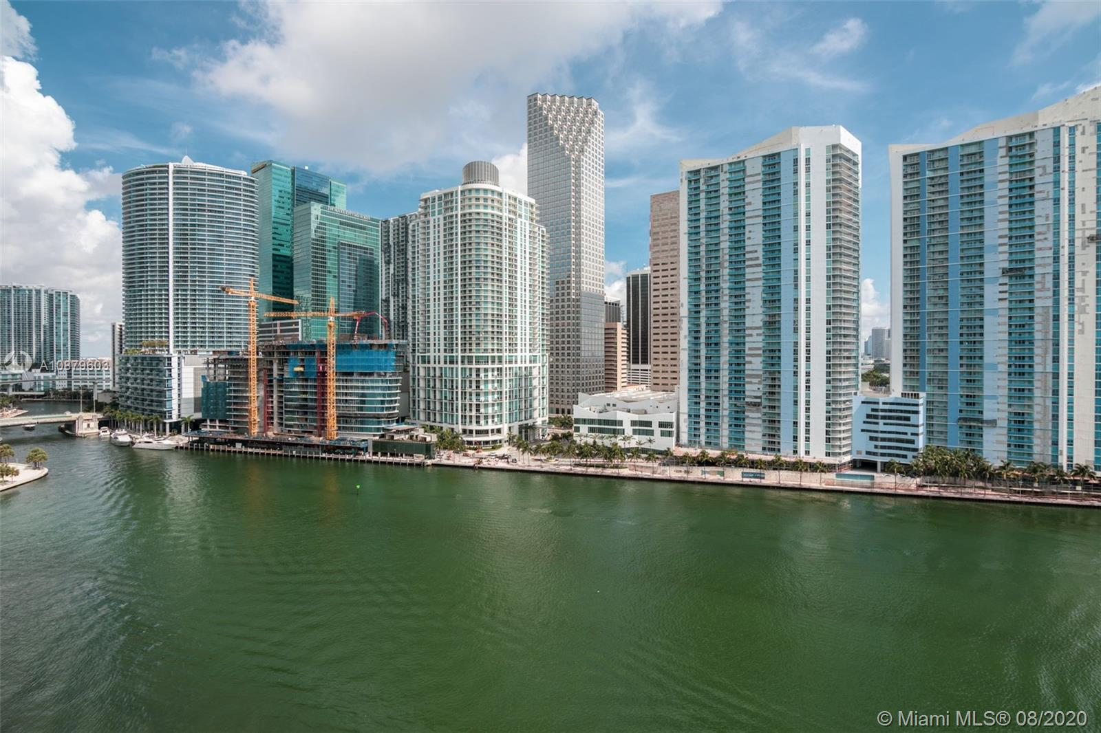 Simple & sophisticated. This condo unit has left no detail unimagined. Very well known Asia building with the perfect unit in line 03. Top of the line appliances. Amazing and breathtaking water and Miami's skylines views, from the floor to ceiling windows. The private elevator opens in your private foyer taking you to the dreamed 12' ceilings unit. Italian chef's style kitchen, spacious master bedroom and  bathroom, with a huge walking closet, and much more. This unit has 1 assigned tandem parking space for two cars  and 1 assigned storage unit.