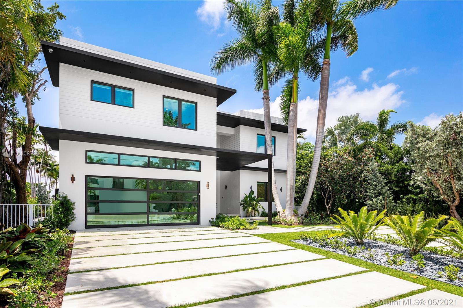 Situated on the Open Bay w/ endless water & west sunset views, this Completely Rebuilt Contemporary home features 7100 SF of Living Space complimented by top of the line finishes throughout. Enjoy a perfect layout for family living & entertainment which features 8 BD, 8.5 BA + home office. The 1st floor sets the tone w/ 60x60 porcelain tiles, one of a kind staircase w/ live green wall & a Snaidero Kitchen comprised of wood taken from the pilasters of Venice. Upstairs you'll be blown away by the master retreat which boasts breathtaking western views of the bay & sunsets, private lounge / sitting room, bespoke master bathroom w/ steam shower & enormous his & hers closets. The backyard provides a tropical setting w/ pool & spa, new seawall cap & brand new 60' dock.