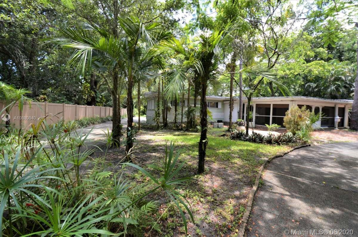"""LOADS OF """"OLD WORLD CHARM"""" IN THIS 3 BED 2 BATH HOME IN THE HEART OF PLANTATION'S COUNTRY CLUB ESTATES-RARELY AVAILABLE 1/2+ ACRE WOODED LOT HOLDING THE 3/2 WITH A HUGE FAMILY ROOM/BONUS ATTACHED UTILITY ROOM AND SEPARATE METAL """"HALF MOON"""" STORAGE SHED/GARAGE WITH ELECTRIC AND 3+ CAR PORT•2 BLOCKS FROM FT LAUDERDALE COUNTRY CLUB•LIGHTED MURT TRAIL!•INTERIOR FEATURES: TERRAZO FLOORS THROUGHOUT•GORGEOUS CIRCLE TROWELED CEILINGS•CUSTOM WALL MURALS•FIREPLACE•EXPOSED BEAM CEILINGS•HUGE CLOSETS•BRICK ACCENT WALLS IN KTICHEN&DINING AREA•SOLID PINE CABINETS•LOADS OF STORAGE••EXTERIOR FEATURES: ROOF 2013•ROLL DOWN HURRICANE SHUTTERS•SCREENED FRONT PORCH•PAVER WALKWAYS & PATIOS + NUMEROUS UNUSUAL FERNS & PALMS•CIRCULAR & LONG DRIVEWAY•35 FOOT CONCRETE RV PAD W/ELECTRIC•"""