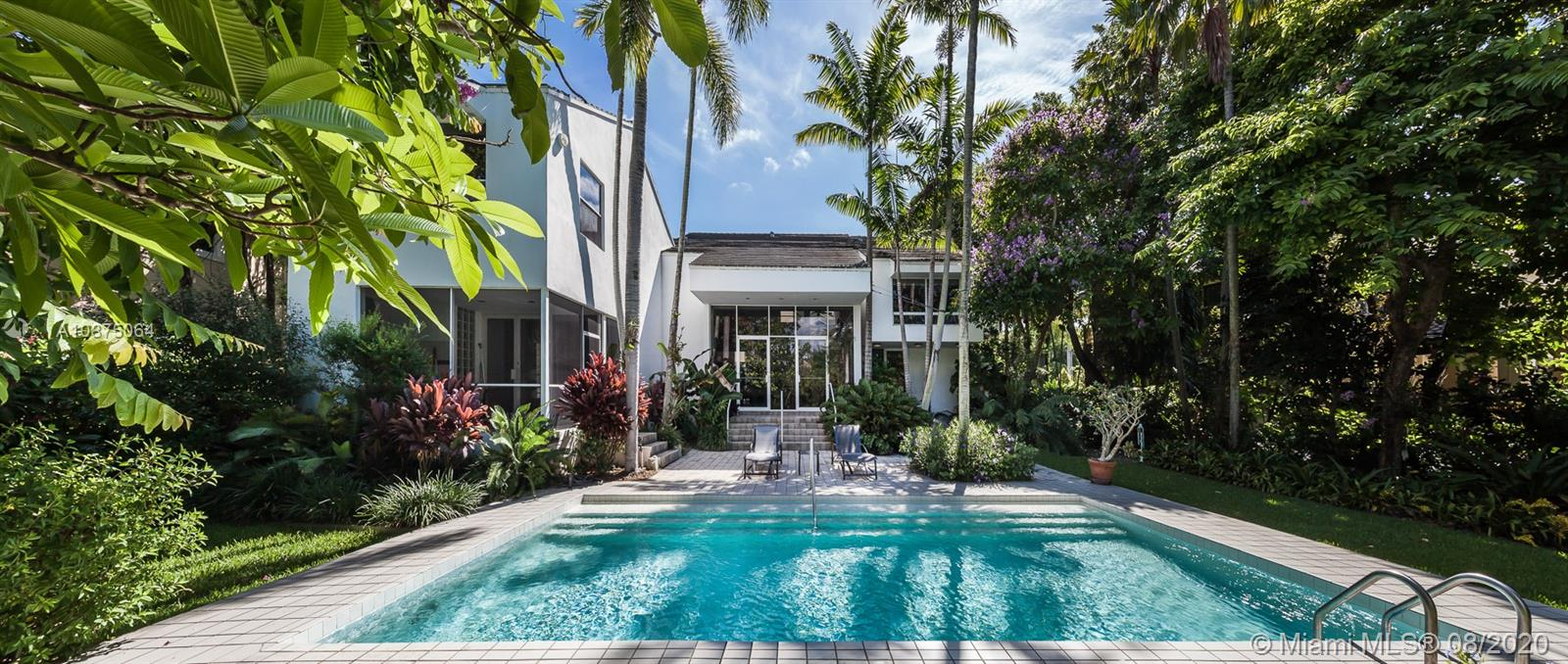 Located in the prestigious Islands of Cocoplum, this contemporary home sits on an 18,676 SqFt lot on a cul-de-sac. Built in 1988, addition in 1992, by famous Peruvian architect Miguel Rodrigo Mazure, this 5,962 total Sq Ft, 4BD/4+1BA home was made for entertaining with a sparkling pool, outdoor BBQ, and brand new 27 foot dock. Convenient access to Biscayne Bay. Landscape design by Raymond Jungles. The living room offers an open layout with a formal dining room and bar great for hosting. Enjoy 3 levels of authentic & unique architecture with natural light illuminating the living room. Interior features: chef's kitchen w/ stainless steel appliances, dine-in kitchen & breakfast area. Primary suite with impressive bathroom, walk-in closet with built-ins and beautiful water views.