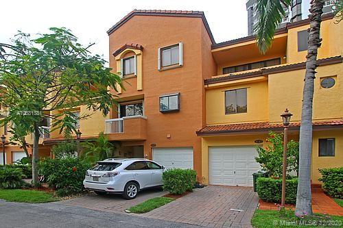 The largest tri-level townhouse in gated Marina Cove with a working elevator with marble floor, 2,646 sq feet per tax roll, 2,900 sq feet per owner as some terrace space was enclosed under A/C. Over 10 foot ceilings in the bedrooms & in some living areas. 2 LIVING ROOMS, ONE UP & ONE DOWN. 4 balconies. All windows have accordion shutters. New laminate wood floors, expensive custom built Brazilian wood staircases. 3 MINUTEs to ALONG THE MARINA TO THE WATERWAYS MALL, DOG PARK, HOUSES OF WORSHIP.