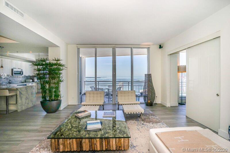 Enter this  Remarkable and substantially renovated residence!  Featuring an open floor plan with spectacular unobstructed views of Biscayne Bay. Generous sized balcony with access from social area and chefs style kitchen.  Three in-suite bedrooms and a fourth/den.  Impressive master suite with private balcony offers mesmerizing views of the Bay and Miami's magnificent skyline!