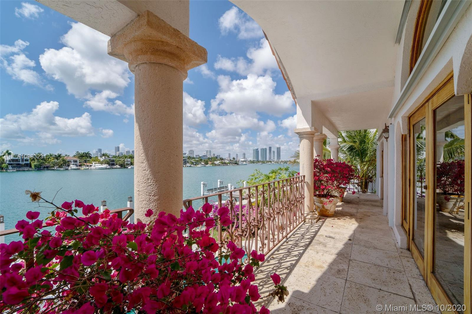 Boater's paradise! Mediterranean gem located in the serene and gated South Hibiscus Island. With southern exposure and unobstructed views of the Miami skyline, this is an absolute must see. 4 bedrooms and 4 baths, plus den masterfully spread out over 4,567 square feet of living area. Chef's kitchen, original cuban tile and large outdoor terrace. Enjoy sweeping bay views from the expansive Master suite balcony and sitting area. A private dock with 60 Feet of frontage completes this magnificent home situated minutes from S Beach, Downtown & the Miami International Airport.