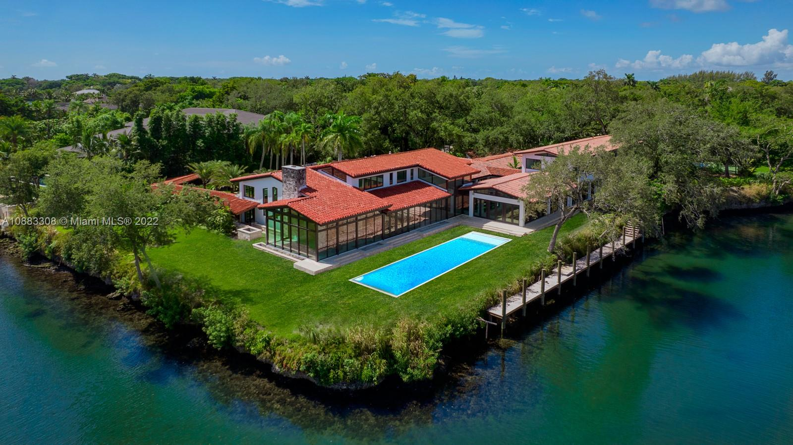 Brand new 2021 compound on the prestigious Granada Boulevard! Situated on the historic Coral Gables waterway on almost 2 acres and boasting 600 FEET of water frontage, this exceptional estate uniquely features a large private dock, 4 car garage, and tennis court. The expansive 15,000SF total area hosts 7 beds + library, 9 baths completed with oak and marble flooring throughout. Step into the grand primary suite with enchanting views of the water and through custom designed glass windows. The chef's kitchen is an epicurean masterpiece designed by Italkraft with top of the line appliances. Natural sunlight pours in throughout the grand family room. The split floorplan is perfect for how you wish to live.