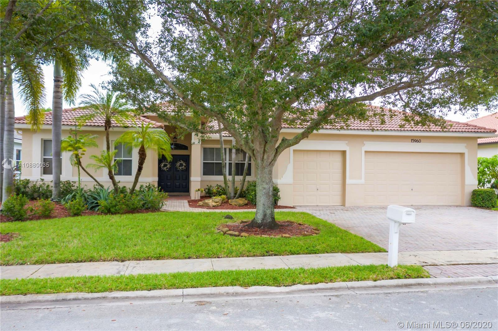 Impeccable one story home in the sought after community of Estates of Pembroke Shores. This 3 bedroom, 2 bath and a Den, which can be converted into the builder's 4th bedroom, is move in ready and well maintained. A/C is 2012 & water heater 2016. The desirable design features a split floor plan, master bedroom wing with double walk in closets and spacious master bath with soaking tub and separate shower, plus double vanities. The large kitchen with walk in pantry opens to an oversized family great room and dining. Outside the pool is surrounded by lush greenery along with a raised flower bed perfect for gardening. The extended pavers allow for plenty of entertaining area as well as a private screened porch perfect for a quiet evening. 24 hr manned guard gate.
