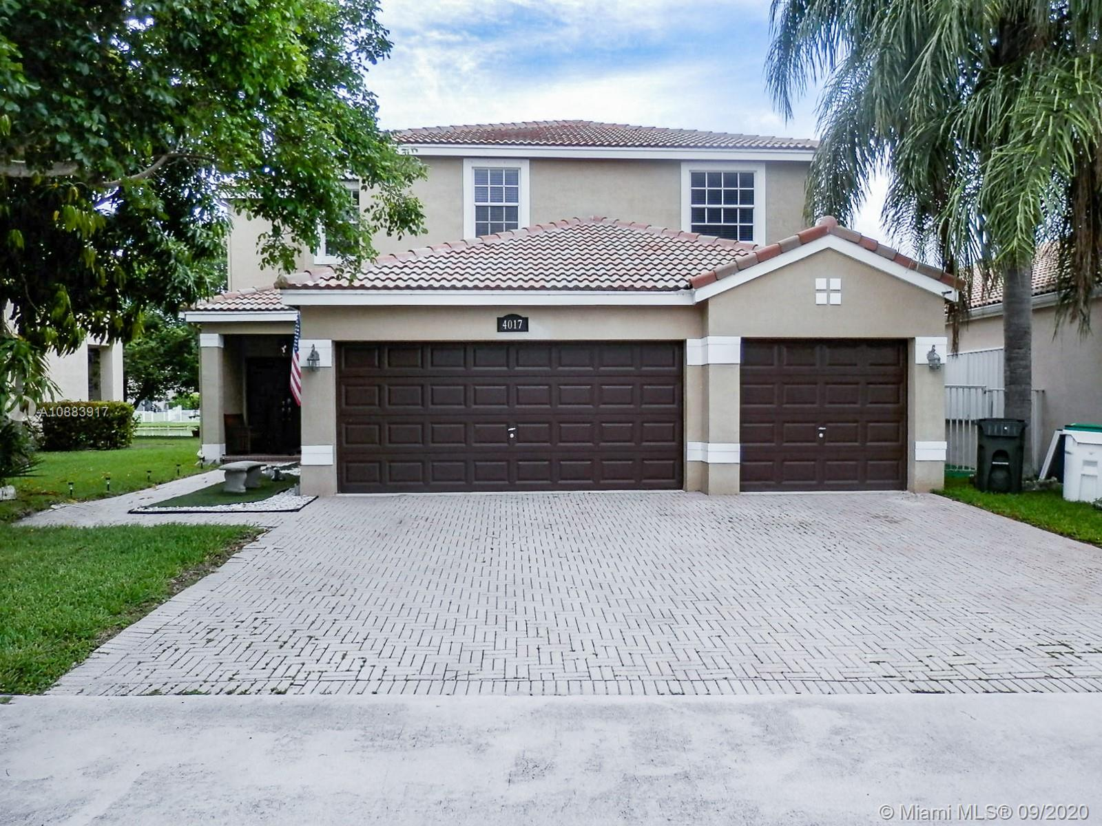 Beautifully detailed home in highly sought after private gated community of Coco Bay- Coconut Creek. Easy access, great amenities & LOW HOA fees! Top Rated School District! A must see & must have - 5 bd\3 ba\3 car garage home with pool/spa & stunning Lake Views! This home is spacious, 2-stories, with open floor plan, SS appliances, granite counter tops and custom cabinets in the kitchen, tile flooring downstairs & wood floors in the bedrooms! All 5 bedrooms are spacious & comfortable, 1 bedroom downstairs, Master upstairs.  Step outside to a fun patio with built in pool & spa, and the views of the lake!  Pool & Spa will receive new Diamond Brite treatment in next few days!!. Enjoy community amenities & The Promenade at Coconut Creek is 2 miles away!