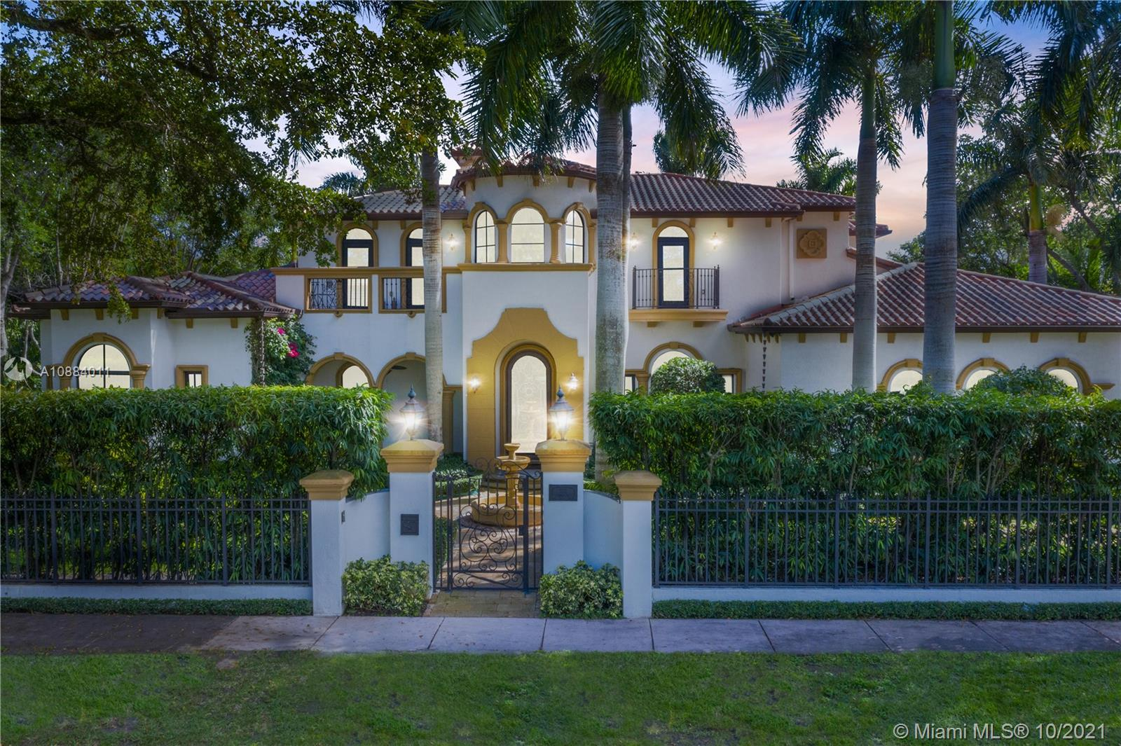 This exquisite residence is tastefully built and set on over half an acre in the heart of Coral Gables. A secluded sanctuary offering a combination of hand crafted natural stones and woodwork including walnut and unique cedar finishes. This beautifully designed, two story home features high ceilings, entertainment area with bar & 400 plus bottle wine cellar, architectural landscape, impact windows and an amazing exposure of VIRTALES art windows on the inside, marble floors, 3 car garage, and a large gourmet kitchen. The driveway and decks are all made from an unique natural stone from Colombia. This home is truly one of a kind and provides those looking for an exclusive residence a retreat from it all while still conveniently located only one mile from Coral Gable's Famous Miracle Mile!