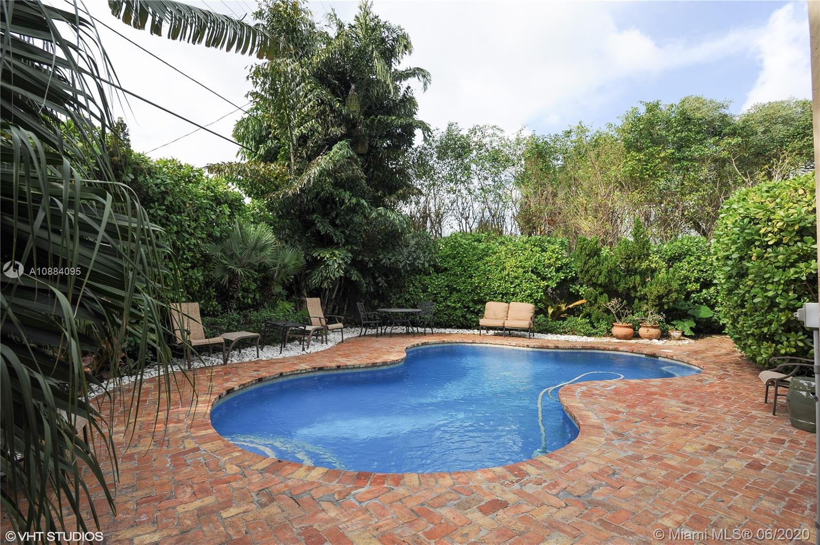 Bay Harbor Islands residence with exquisite architecture and beautiful lines. Make this zen inspired bungalow your own tropical oasis. Relax by the private pool tucked behind lovely landscaping, with heater and chiller for those hot summer days. Or walk to pristine beaches, houses of worship, Bal Harbour Shops and Town of Surfside. This home is unmatched with any for this price.